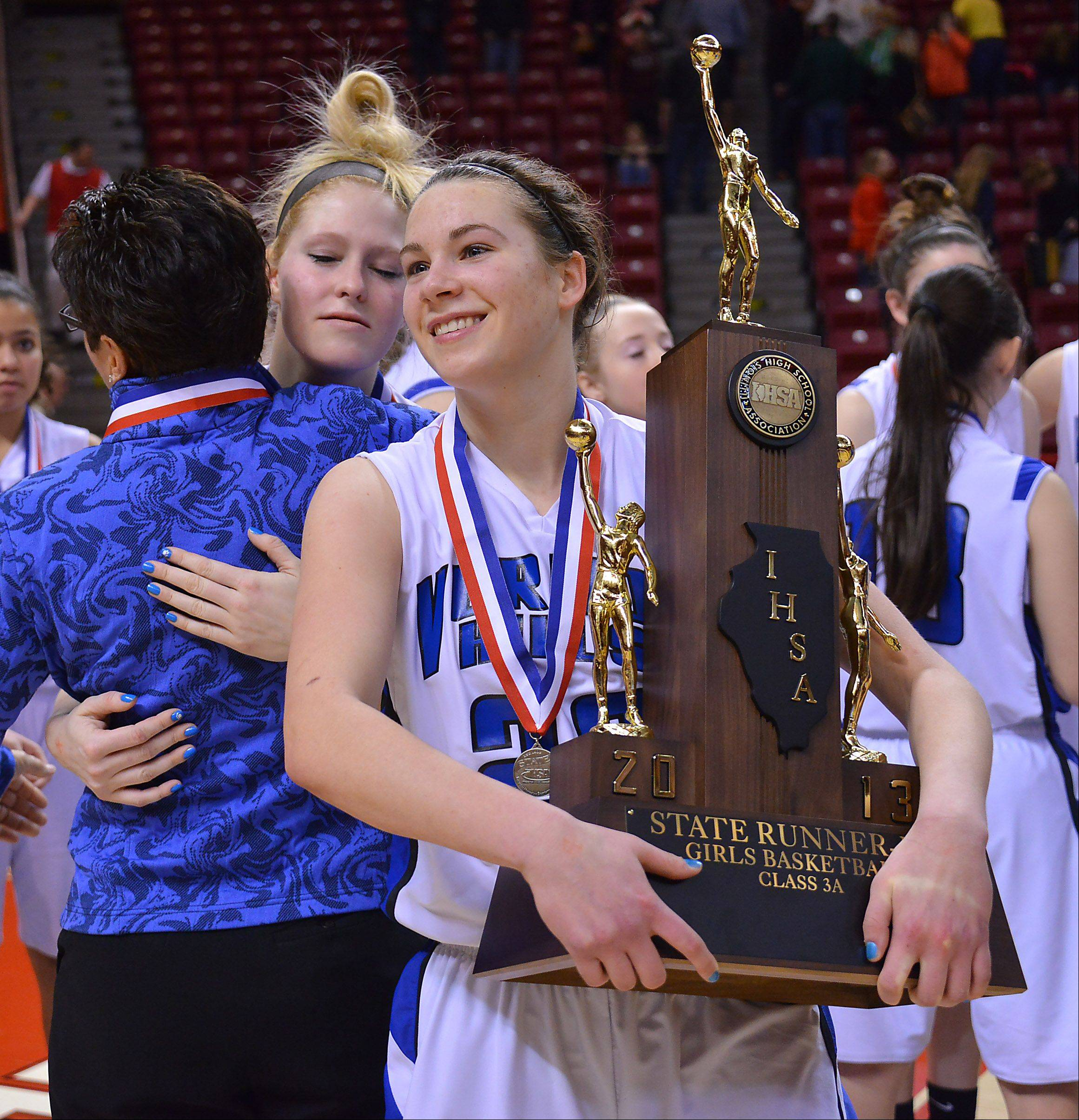 Vernon Hills Brie Bahlmann is all smiles as she holds the second place trophy after losing to Quincy Notre Dame Notre Dame at the Class 3A state girls basketball championship game in Normal on Saturday.