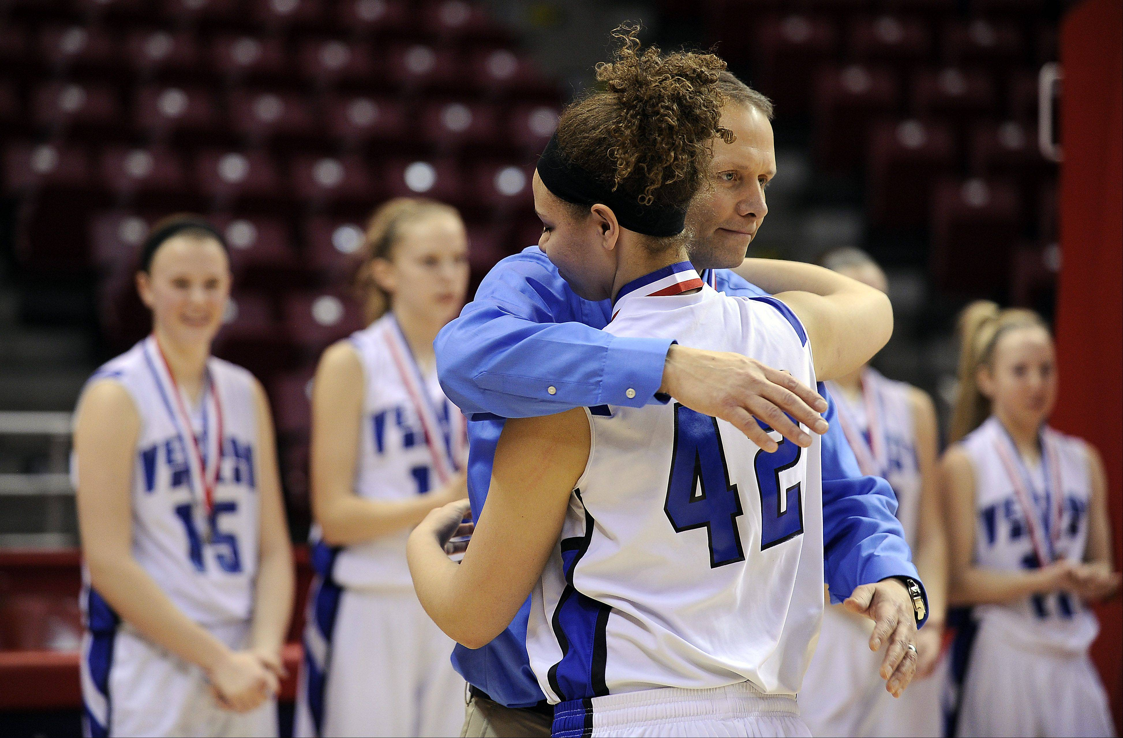 Vernon Hills coach Paul Brettner hugs Lauren Webb after they lost to Quincy Notre Dame in the Class 3A state girls basketball championship game in Normal on Saturday.