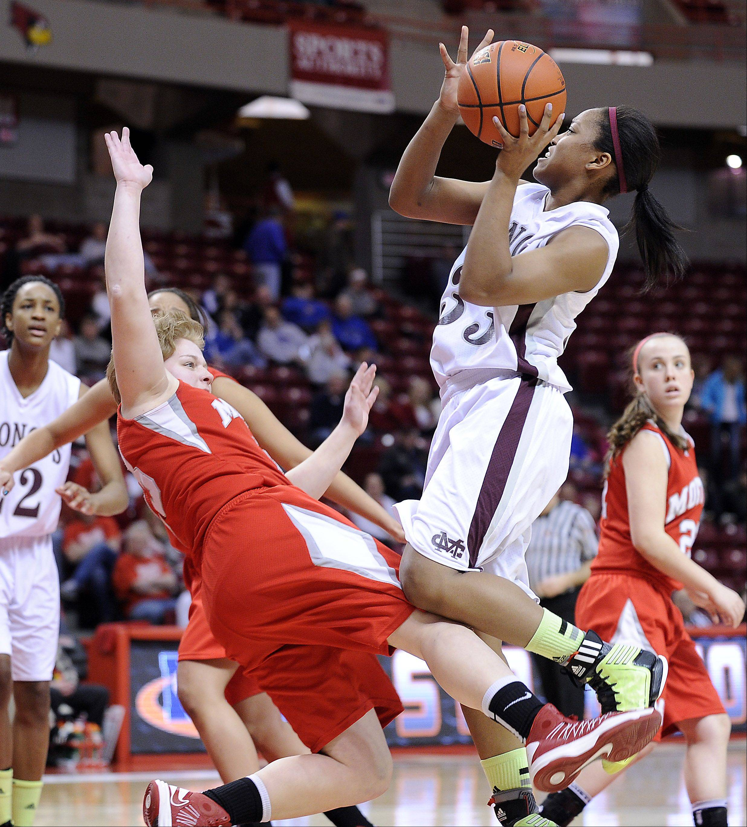 Montini's Sara Ross shoots for two in the first quarter of the Class 3A girls state basketball third place game in Normal on Saturday.