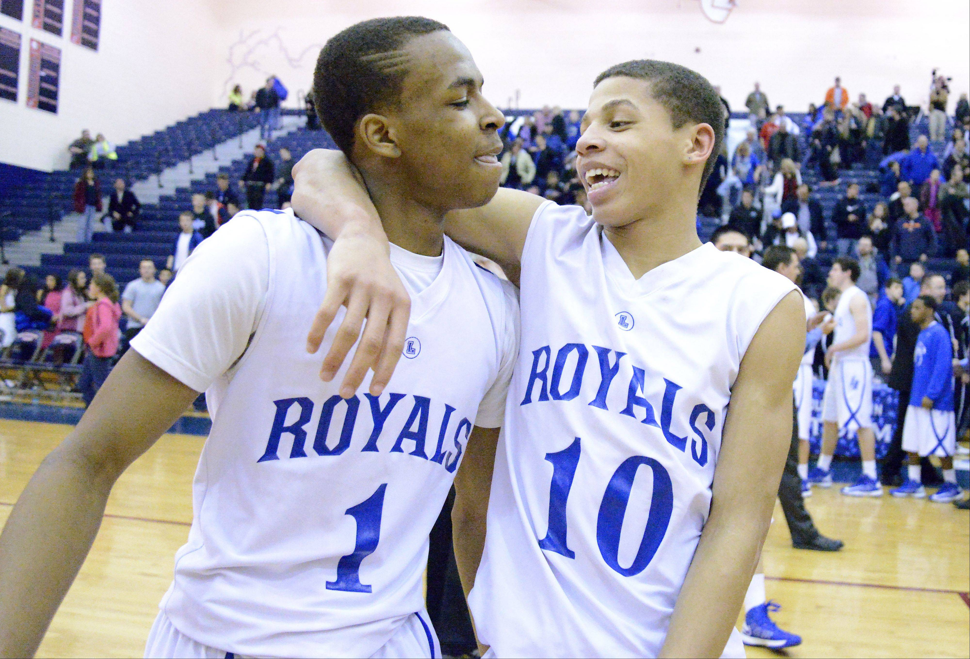 Larkin's Quantice Hunter, left, and Kendale McCullum celebrate the Royals' win over St. Charles North in the Class 4A South Elgin regional championship game on Friday. Larkin is scheduled to play Rockford Jefferson on Tuesday night in the DeKalb sectional semifinals.