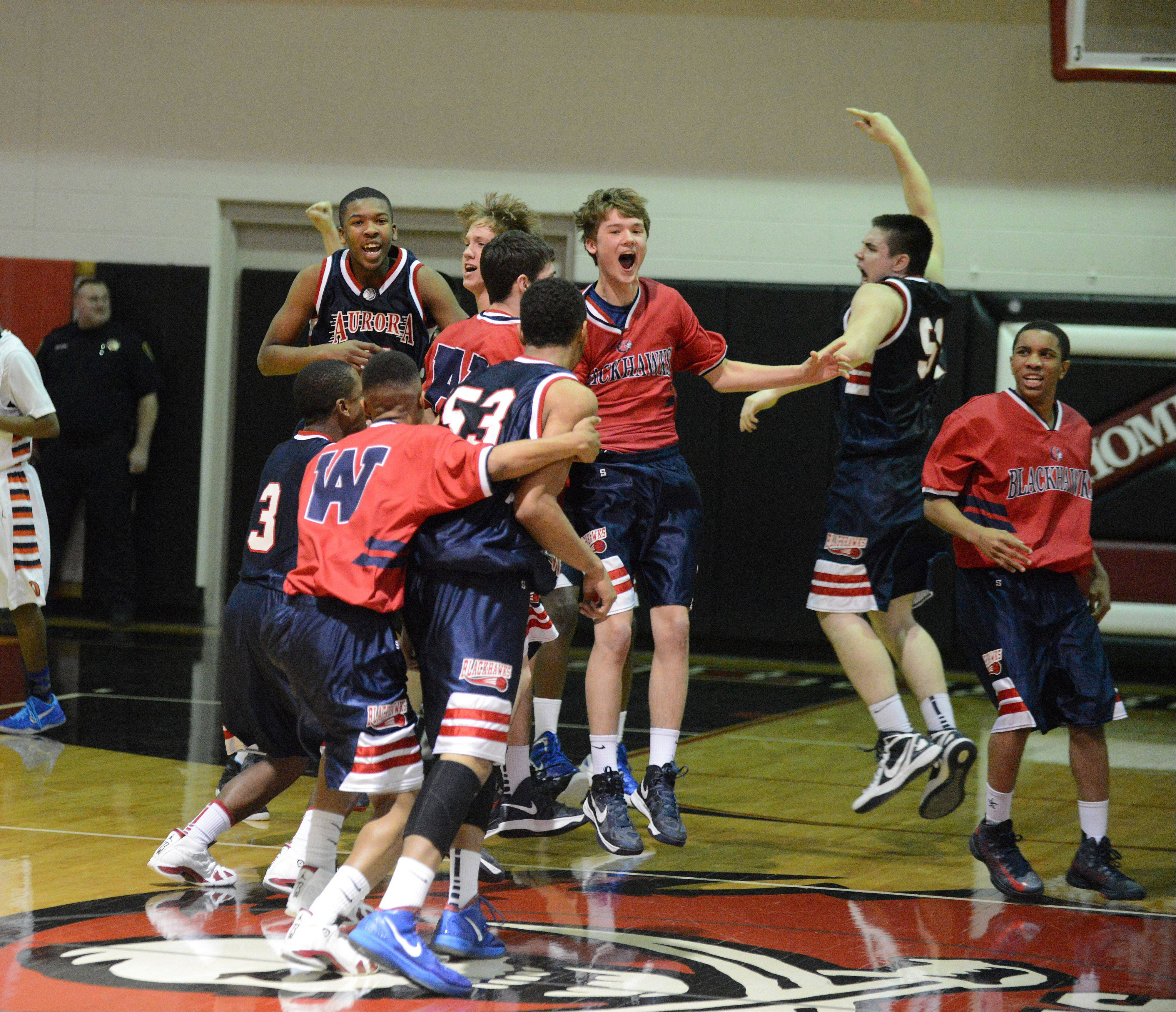 West Aurora reacts to its win over Oswego Wednesday at the Class 4 Bolingbrook sectional.