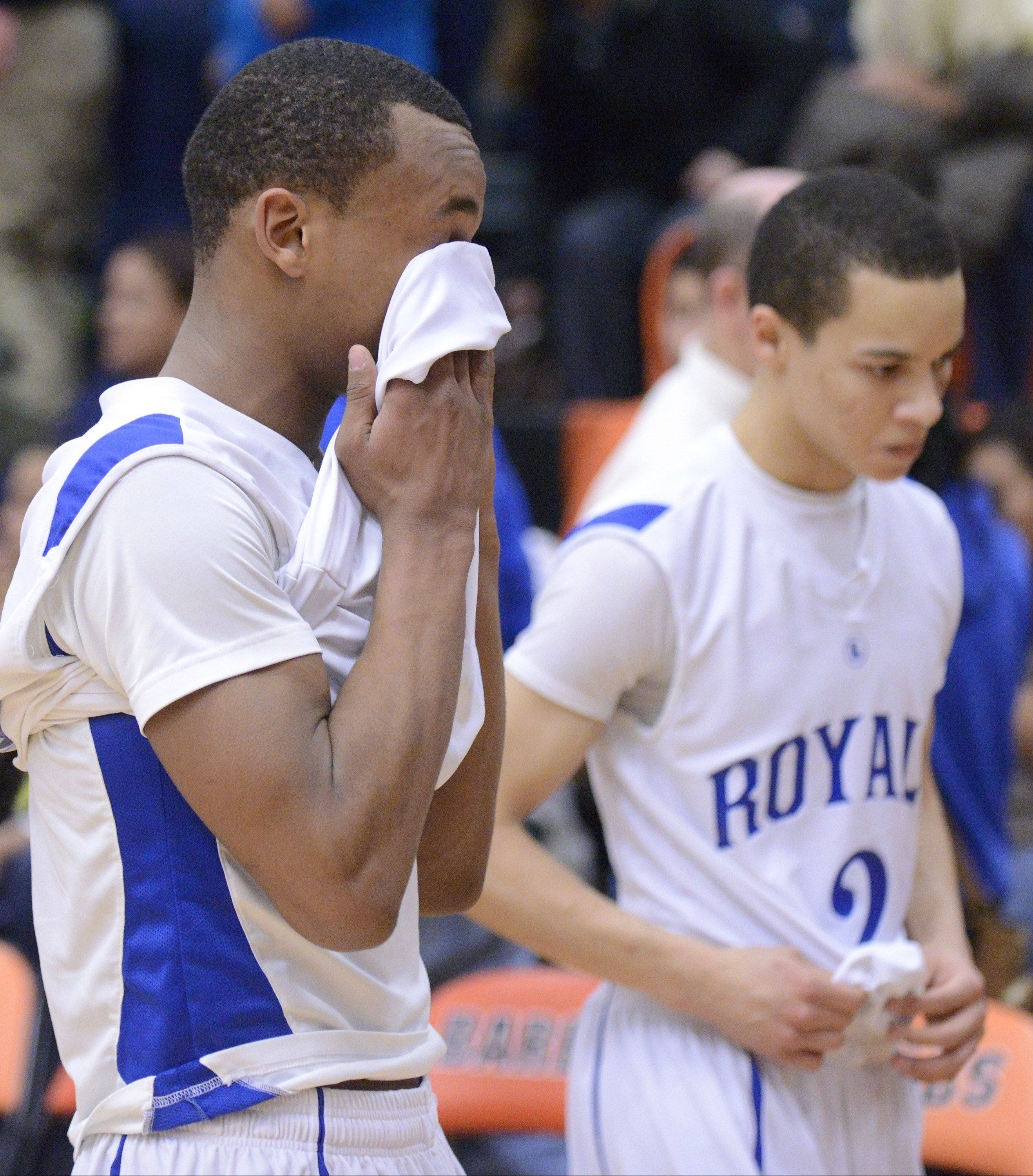 Larkin's Quentin Ruff wipes tears from his eyes as he walks with teammate Derrick Streety after the Royals' loss to Rockford Jefferson.