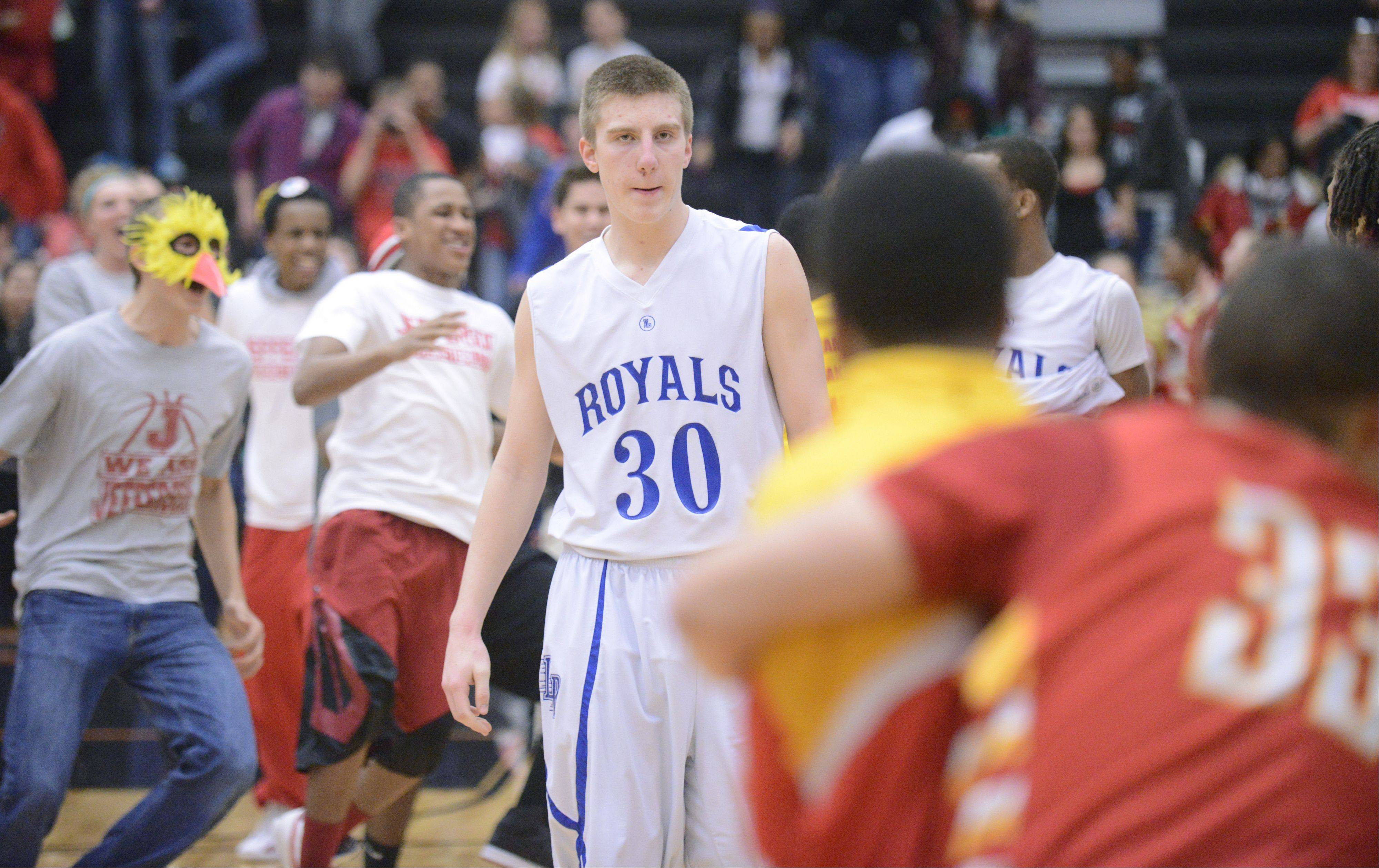 Larkin's Brayden Royse walks among celebrating teammates and fans from Rockford Jefferson after the Royals' loss to them in the Class 4A DeKalb sectional semifinals on Wednesday, March 6.