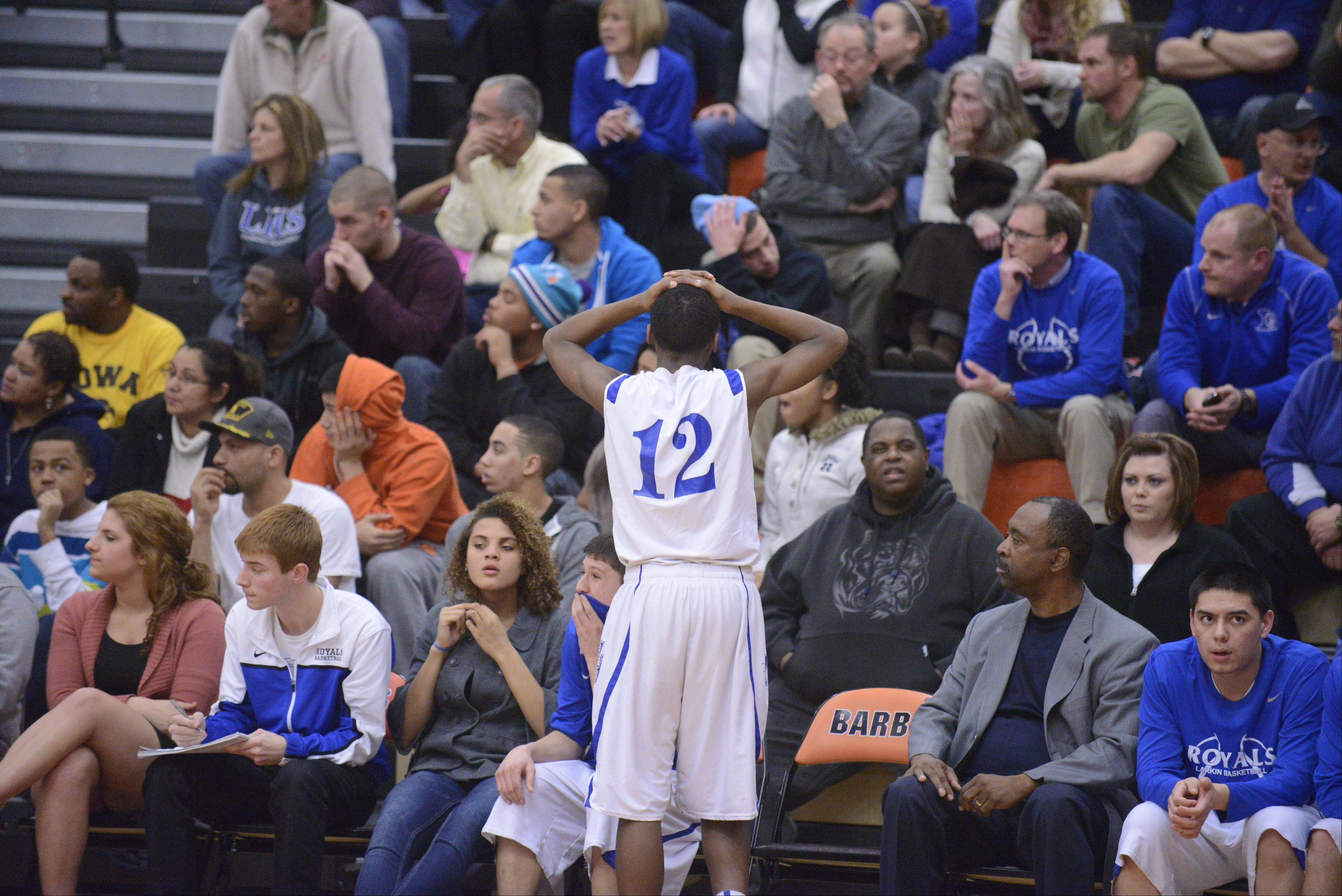 Larkin's Hannibal Marshall realizes the Royals will lose to Rockford Jefferson's in the final minute of the fourth quarter of the Class 4A DeKalb sectional semifinals on Wednesday, March 6.