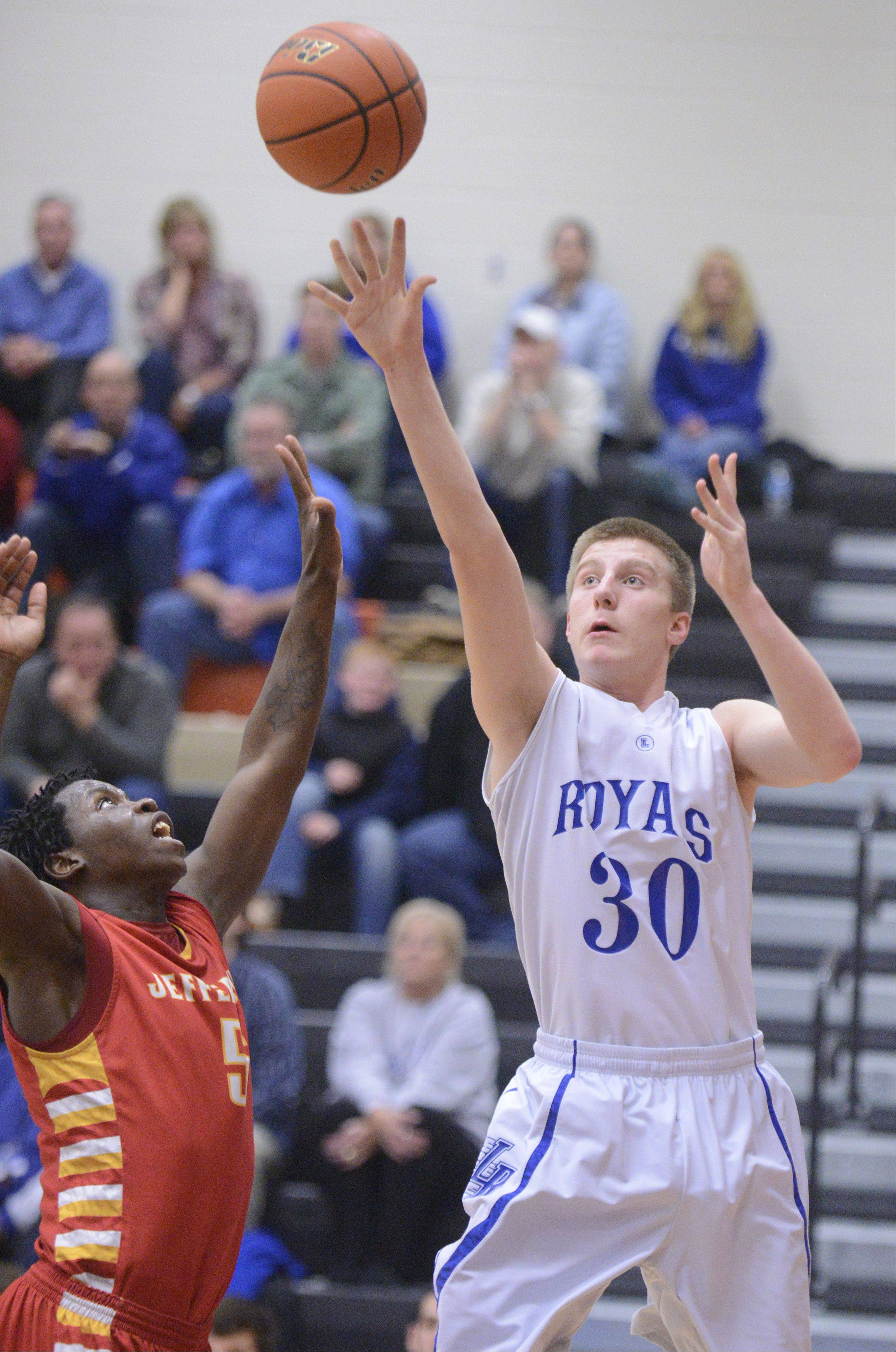 Larkin's Brayden Royse shoots over Rockford Jefferson's Montel Brown in the third quarter of the Class 4A DeKalb sectional semifinals on Wednesday, March 6.