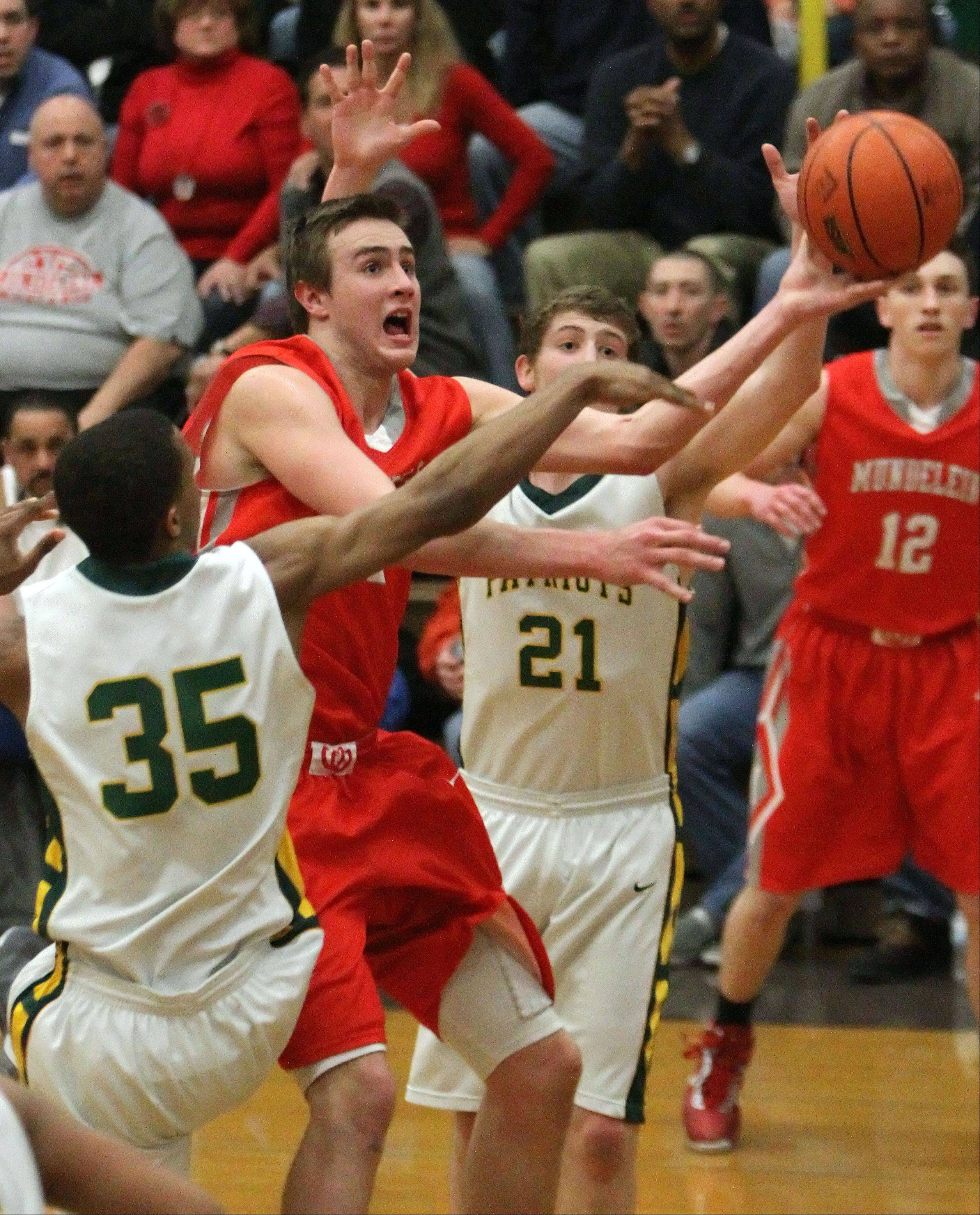 Mundelein's Sean O'Brien, right, drives past Stevenson's Connor Cashaw during the Class 4A Waukegan sectional semifinals Wednesday night.