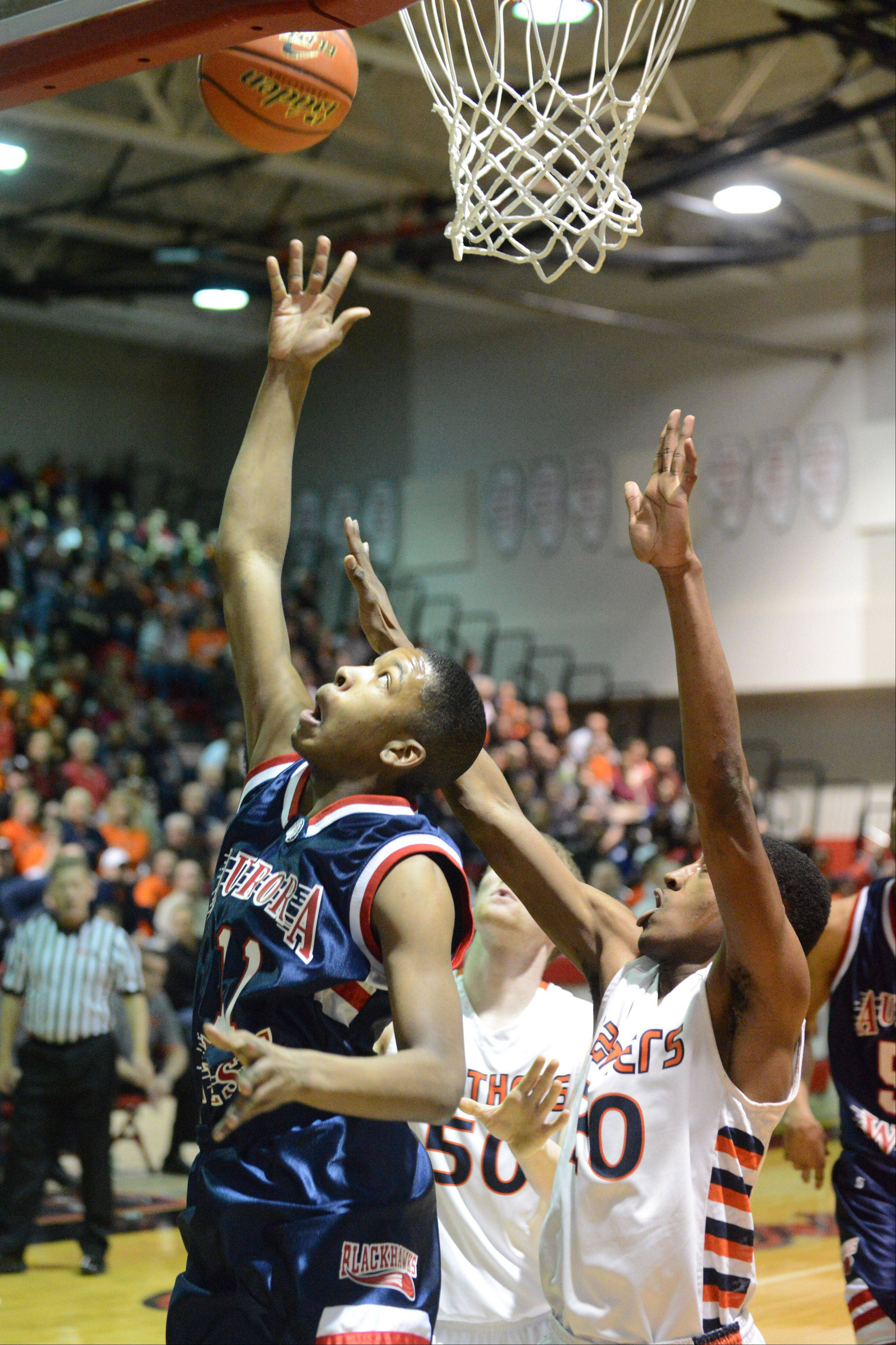 Jontrel Walker of West Aurora takes a shot during the West Aurora vs. Oswego at the Bolingbrook sectional semifinals Wednesday.