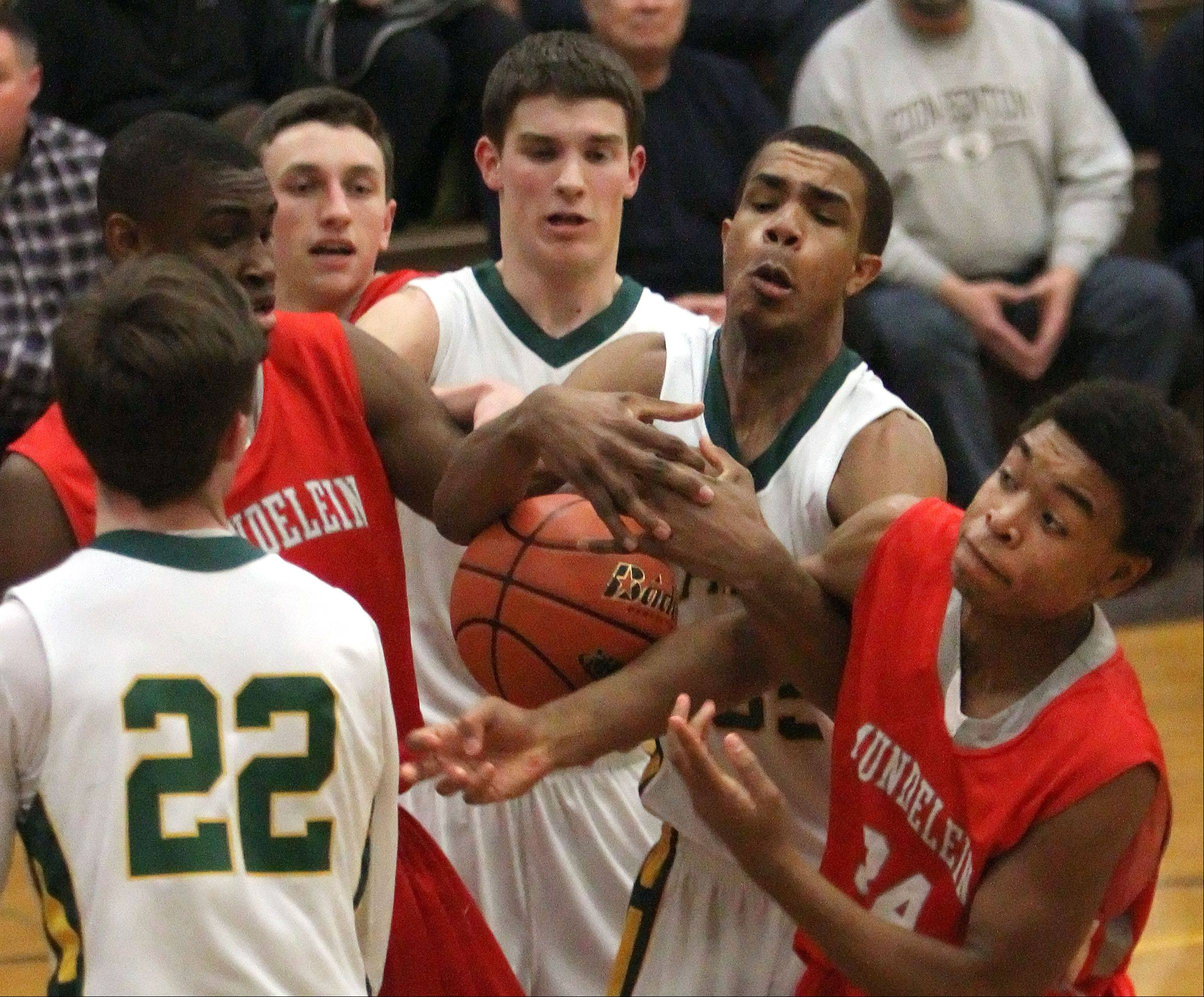 Players from Steveson and Mundelein scramble for a loose ball.