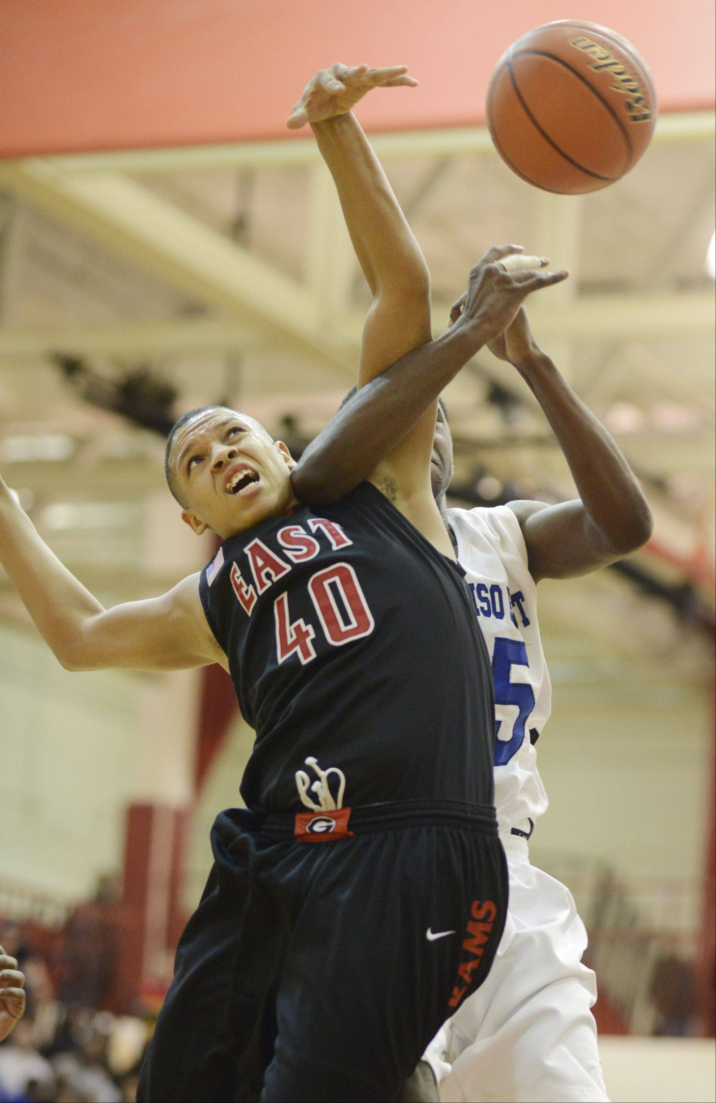 Glenbard East's Tahron Harvey, left, and Proviso East's Parrish McCullum make contact on a rebound .