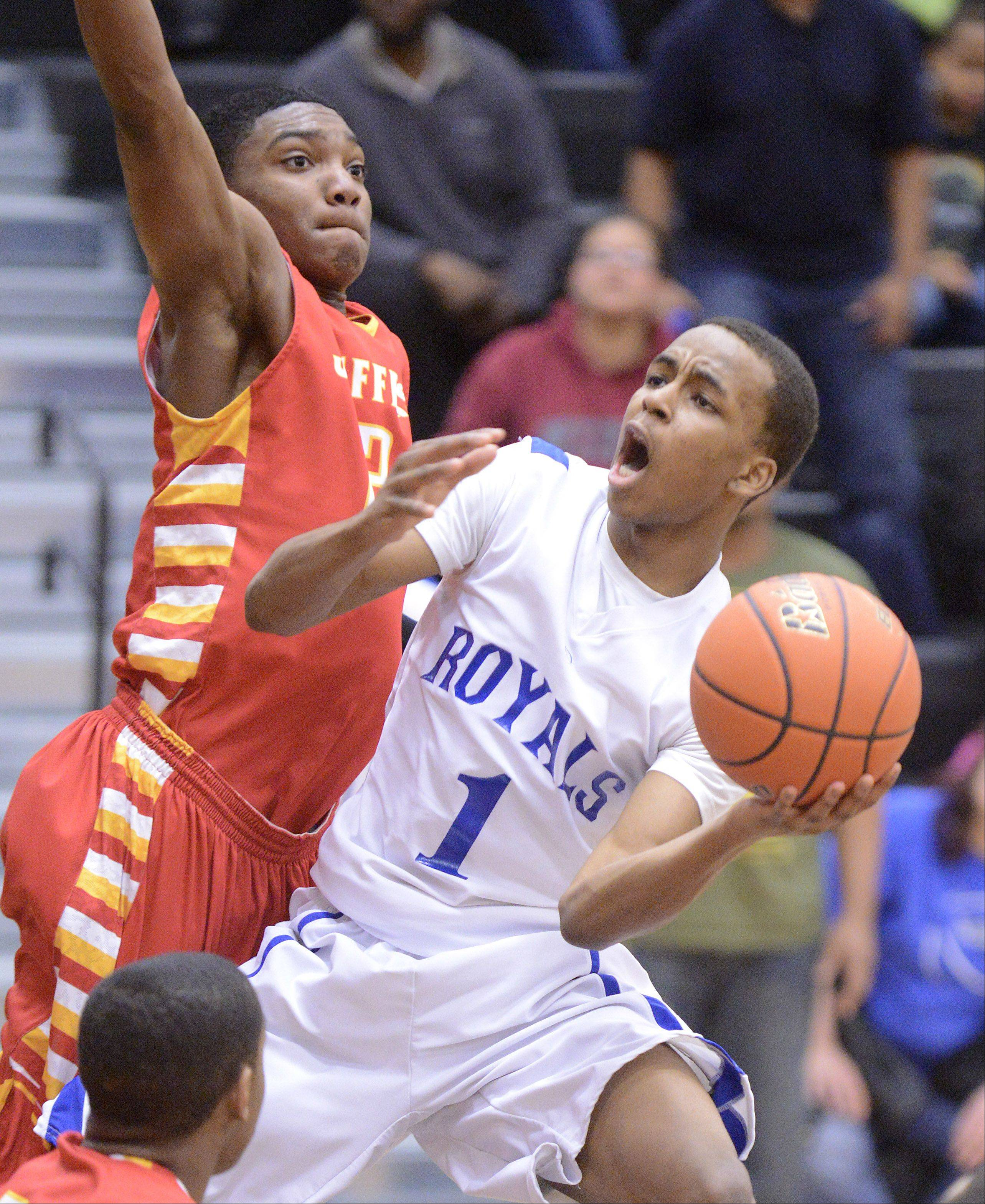 Larkin's Quantice Hunter shoots around Rockford Jefferson's Antonie Pittman in the third quarter .
