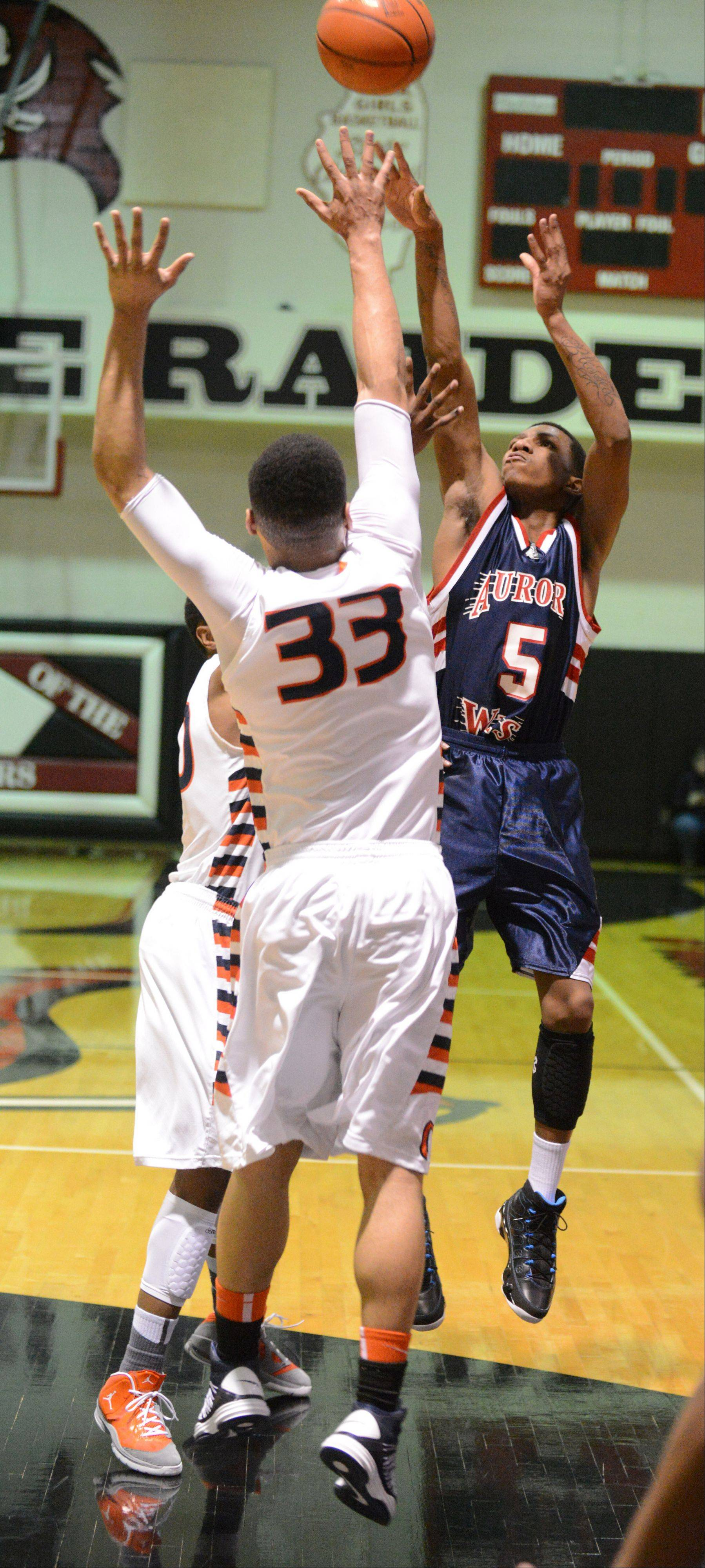 Jayquan Lee of West Aurora takes a three-point shot.
