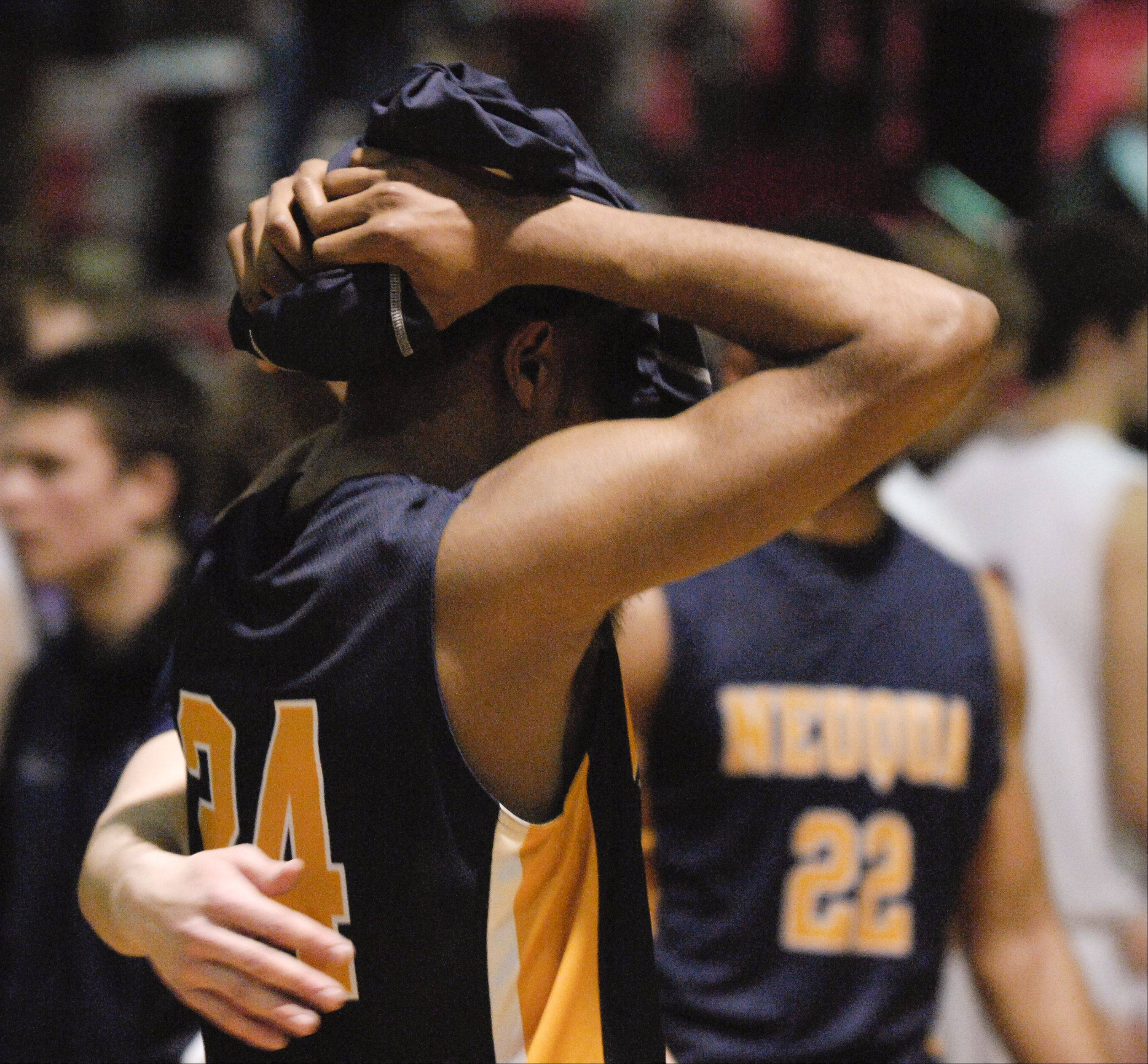 Jabari Sandifer of Neuqua Valley reacts to loosing to Benet in the boys basketball in Class 4A Bolingbrook sectional semifinals in Bolingbrook, 68-62.
