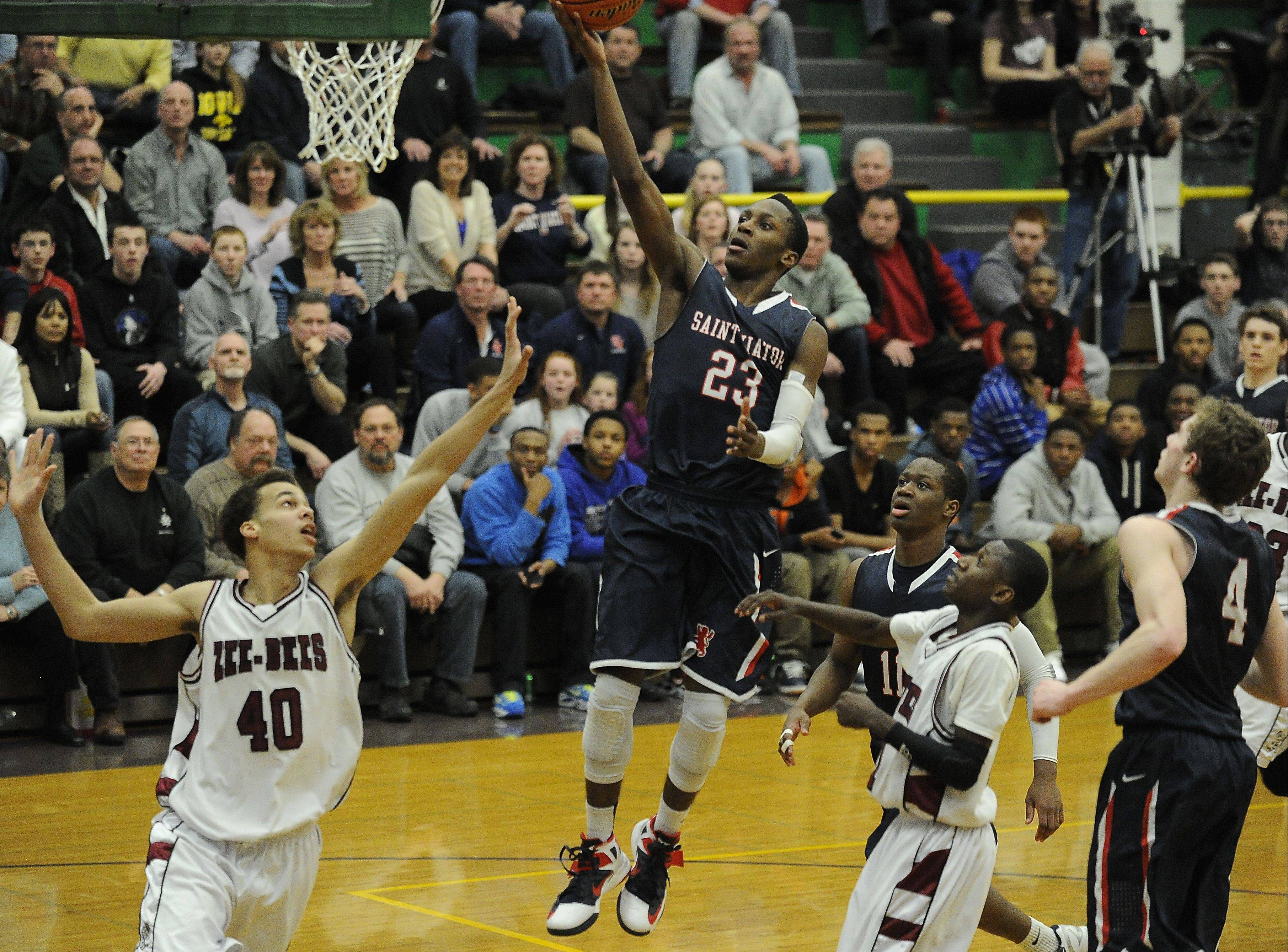 St. Viator's Ore Arogundade delivers a bucket in the fourth quarter to help the Lions past Zion-Benton in the Waukegan sectional Thursday.