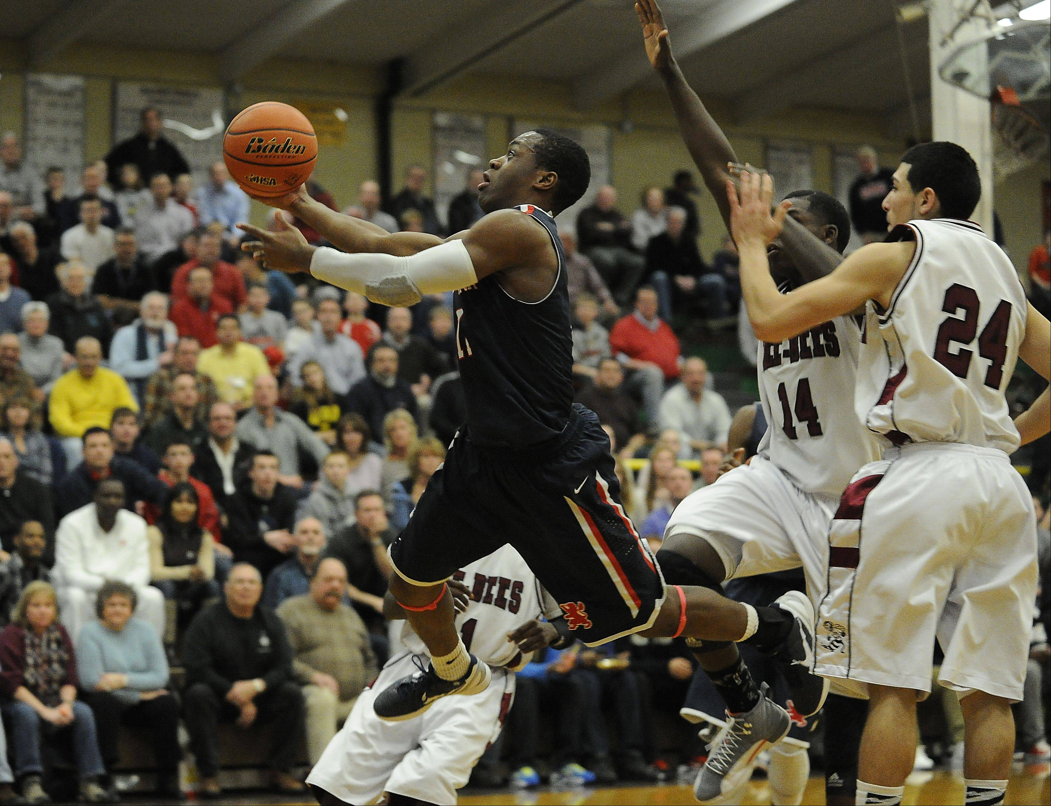 St. Viator's Mayo Arogundade scores in the fourth quarter to help the Lions past Zion-Benton in the Class 4A Waukegan sectional semifinals Thursday.