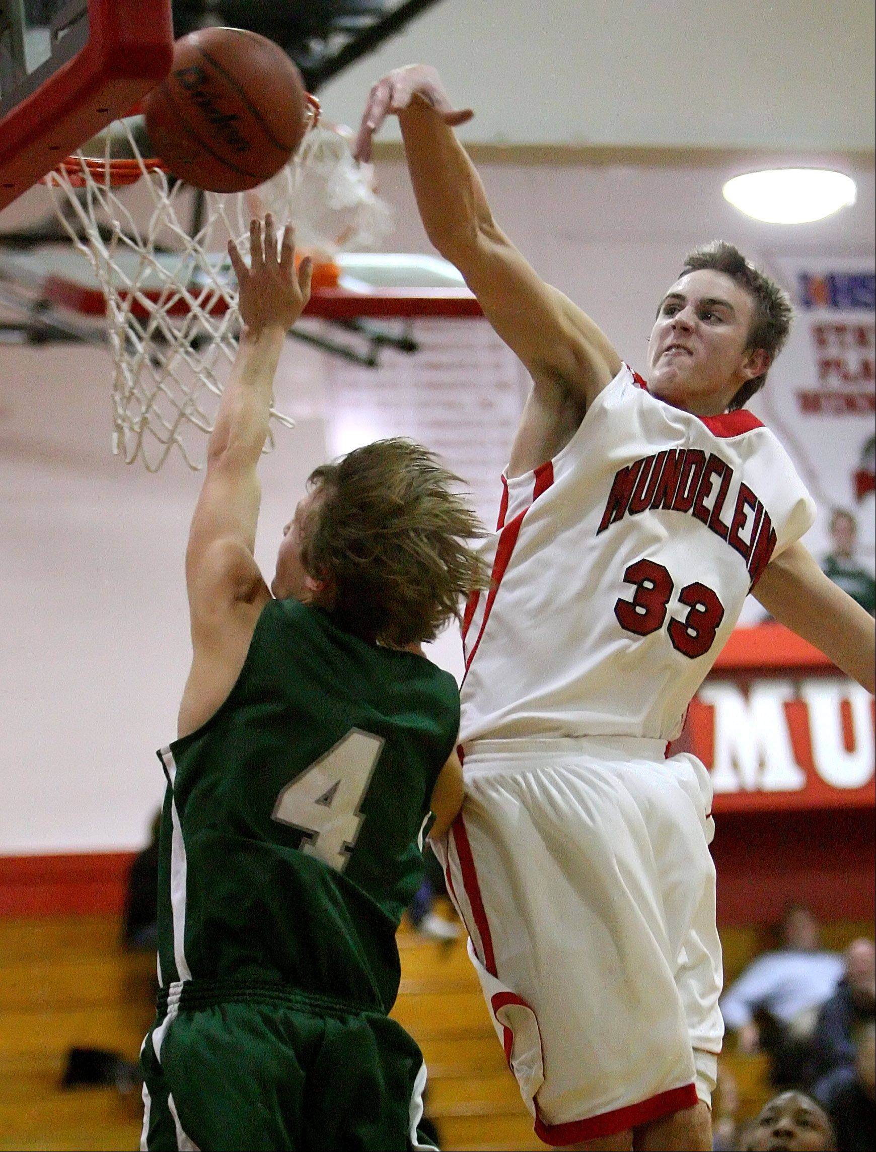 Mundelein's Sean O'Brien, right, blocks a shot.