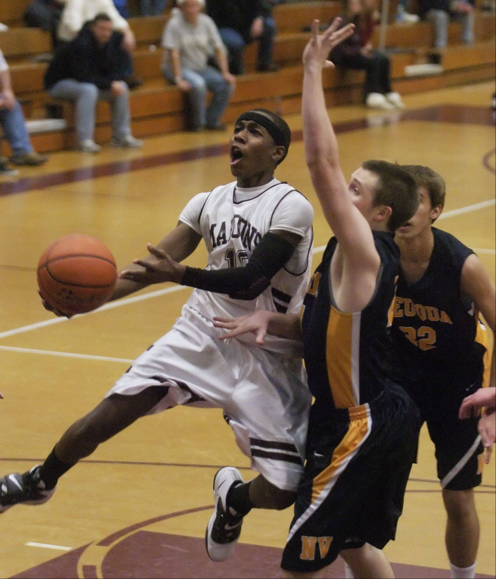 Arie Williams of Elgin drives with the ball.