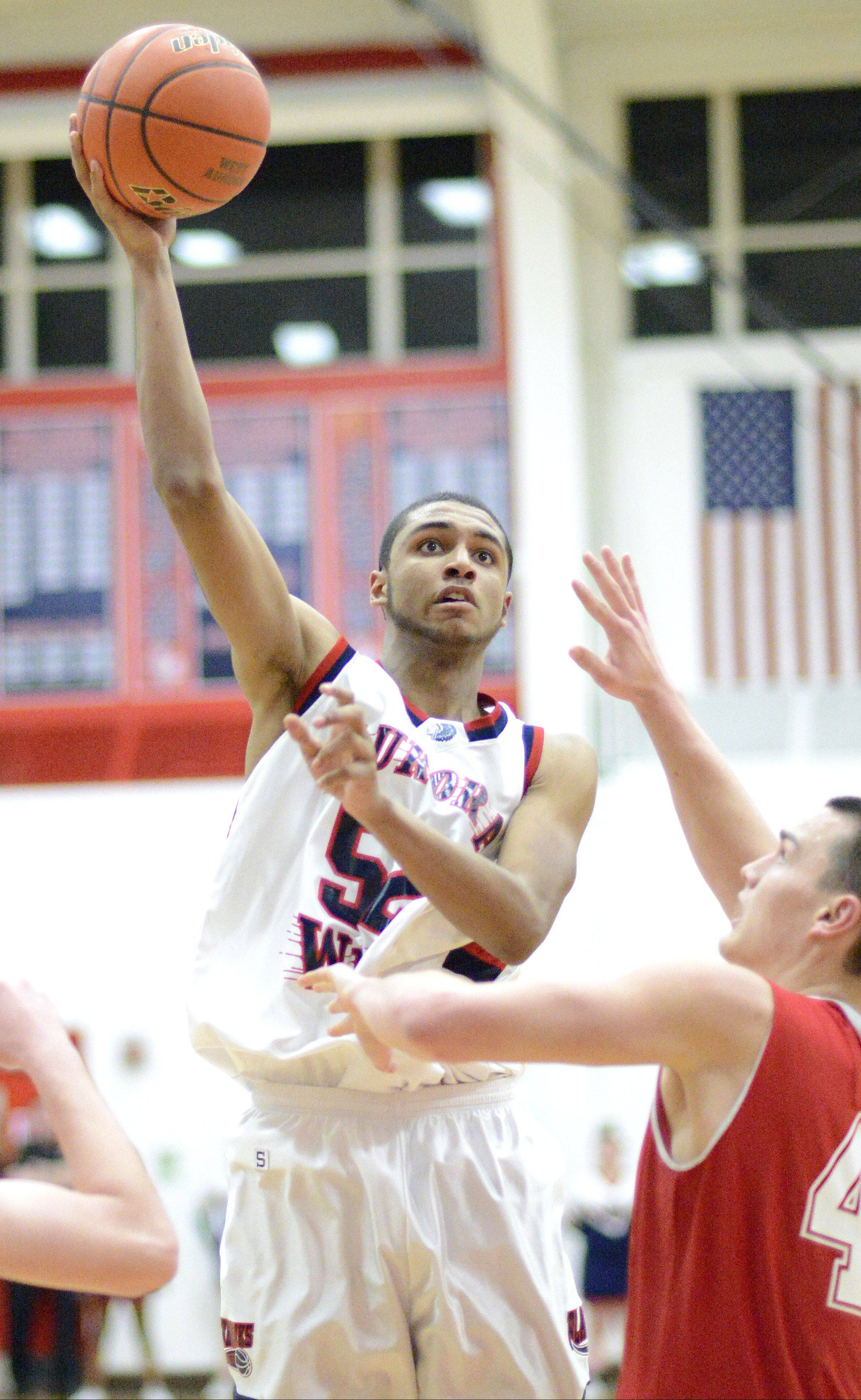 While West Aurora senior Josh McAuley was a thorn in the side to anyone who dared drive the lane with 94 blocked shots, his improvement on the offensive end keyed the Blackkhawks' big year.
