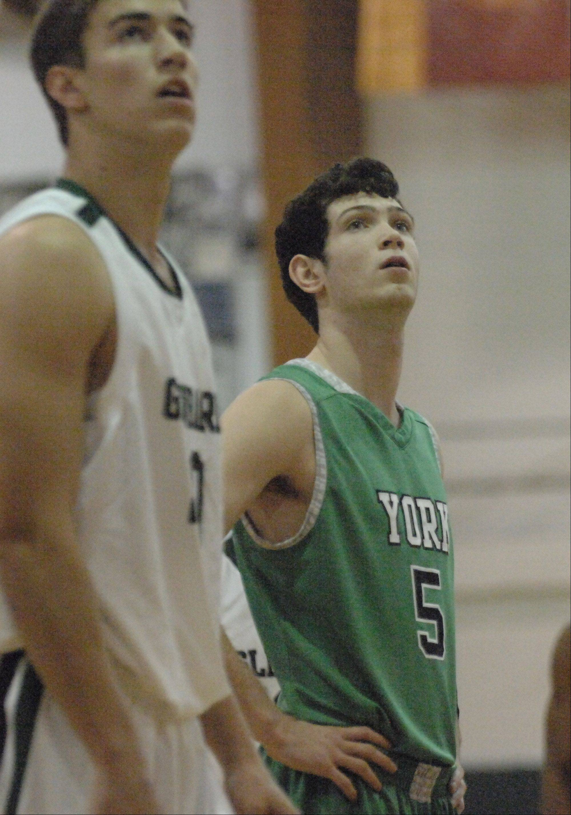 Paul Michna/pmichna@dailyherald.com � David Cohn of York takes part in the York at Glenbard West boys basketball game Friday.