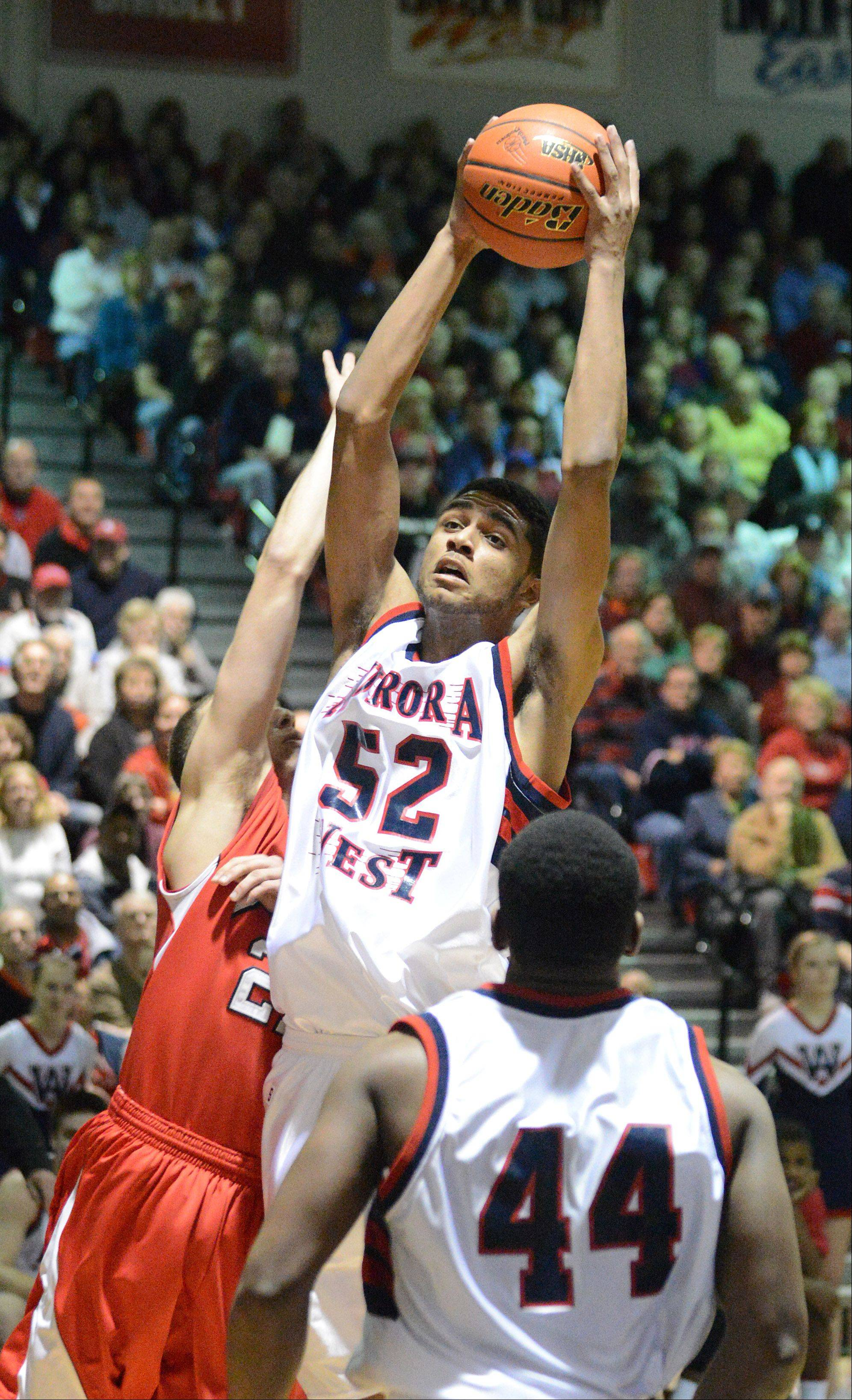 Joshua Mcauley of West Aurora on the rebound during the West Aurora vs. Benet Bolingbrook sectional championship game Friday.