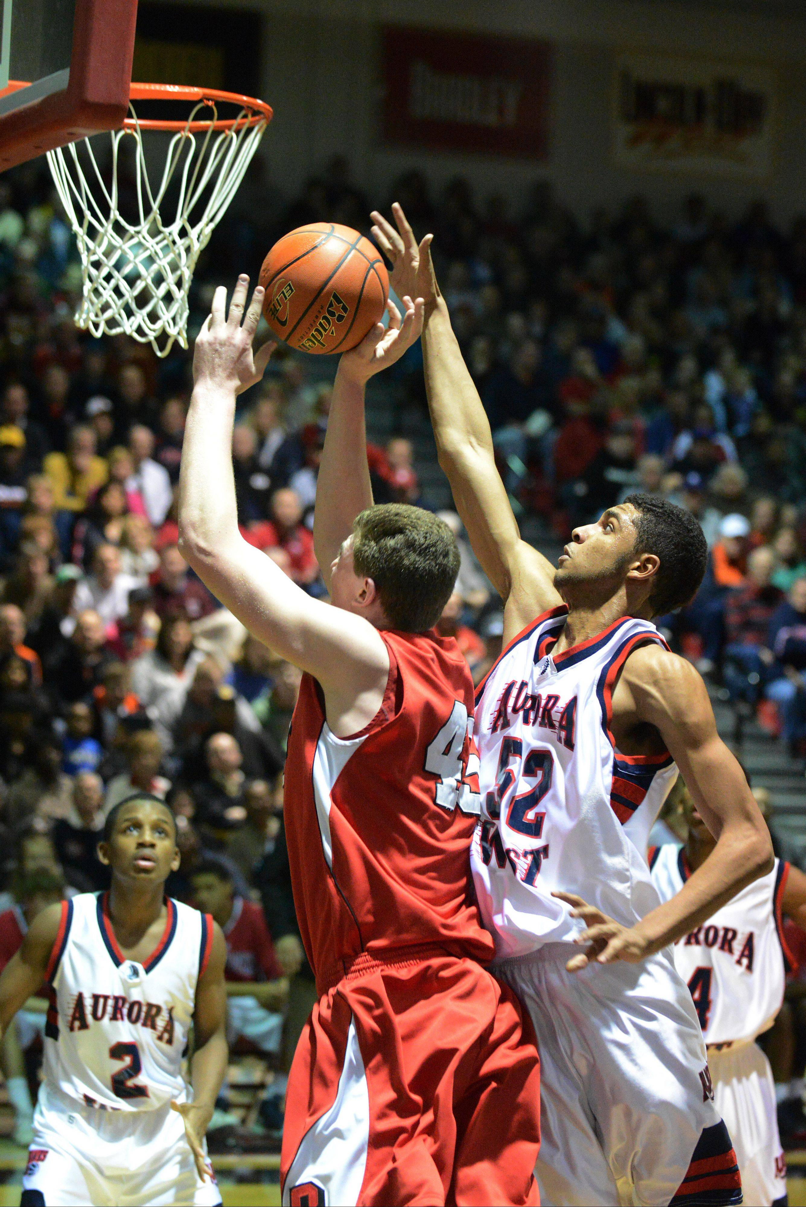 West Aurora's Josh McAuley and Benet's Sean O'Mara battled inside all night.