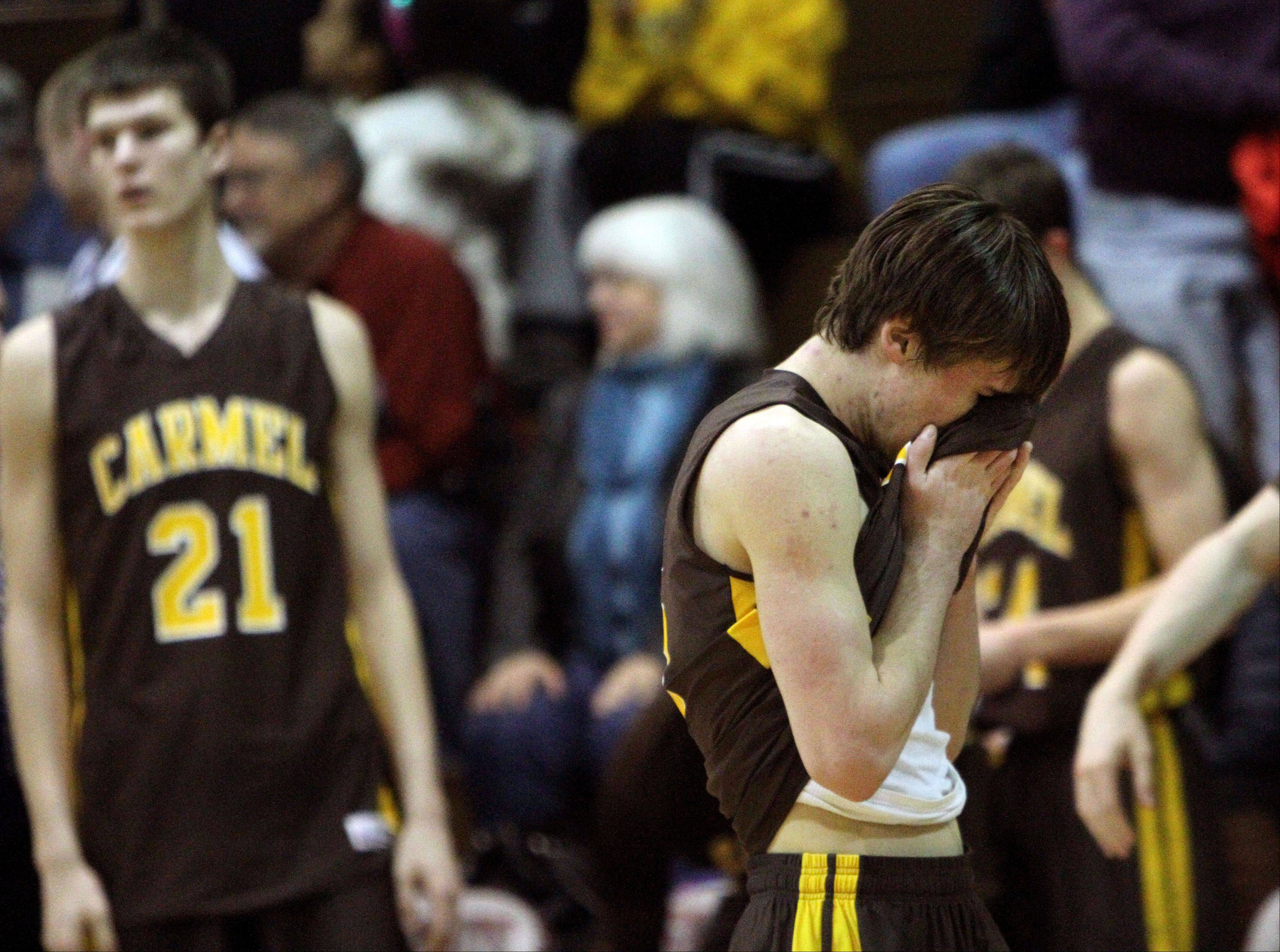 Carmel's Greg Edkins hang his head after the Corsairs' loss to North Chicago in the Class 3A sectional final at Antioch on Friday night.