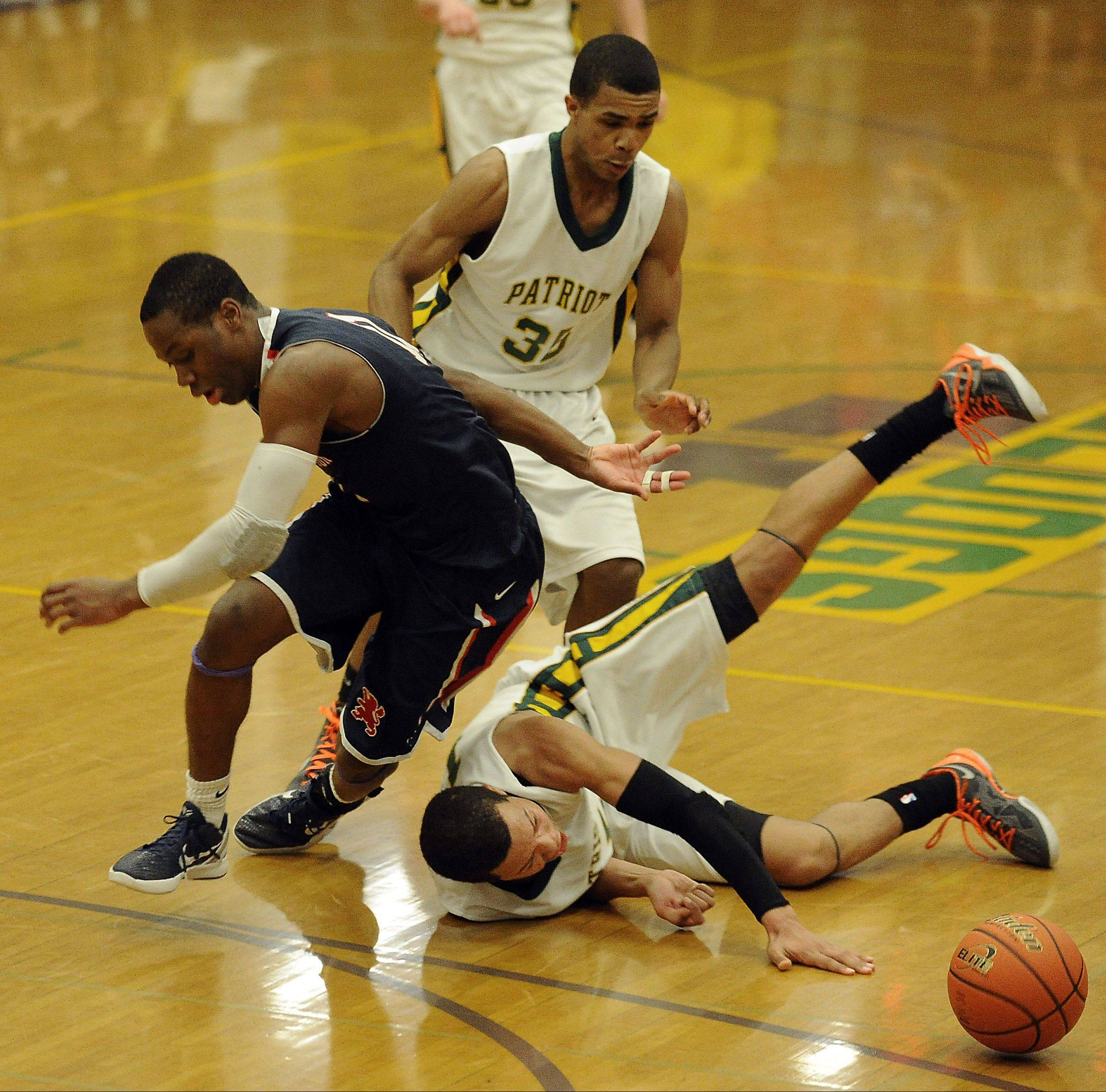 Stevenson's Jalen Brunson and teammate Connor Cashaw collide with St. Viator's Mayo Arogundade in the fourth quarter of Class 4A sectional championship play Friday in Waukegan.
