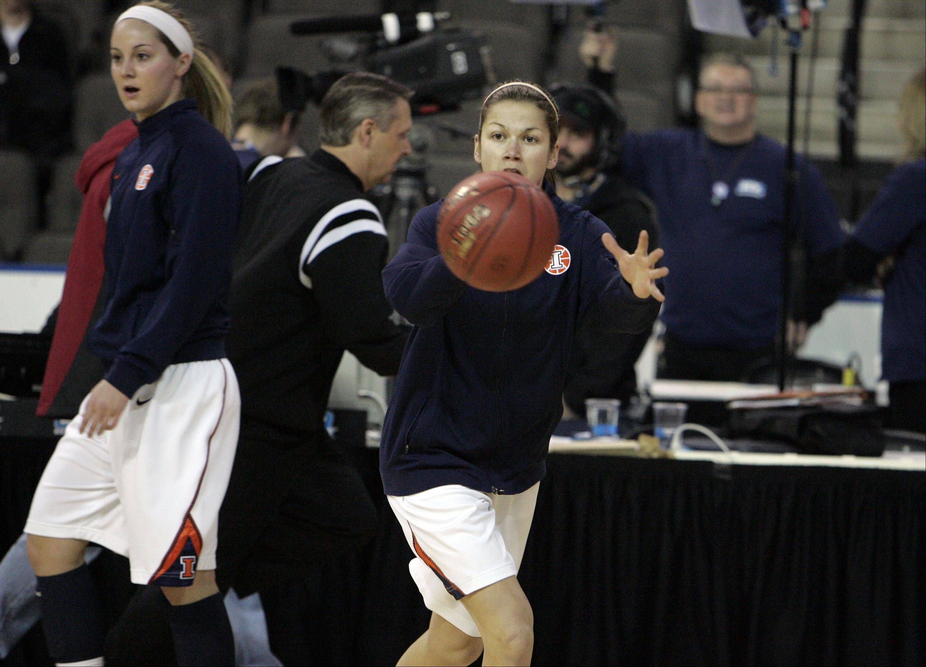 Hampshire and ECC graduate Cassie Dumoulin, who played at Illinois this season, passes the ball in warm-ups prior to the Illini's loss to Wisconsin Thursday at the Big Ten women's basketball tournament at the Sears Centre in Hoffman Estates.