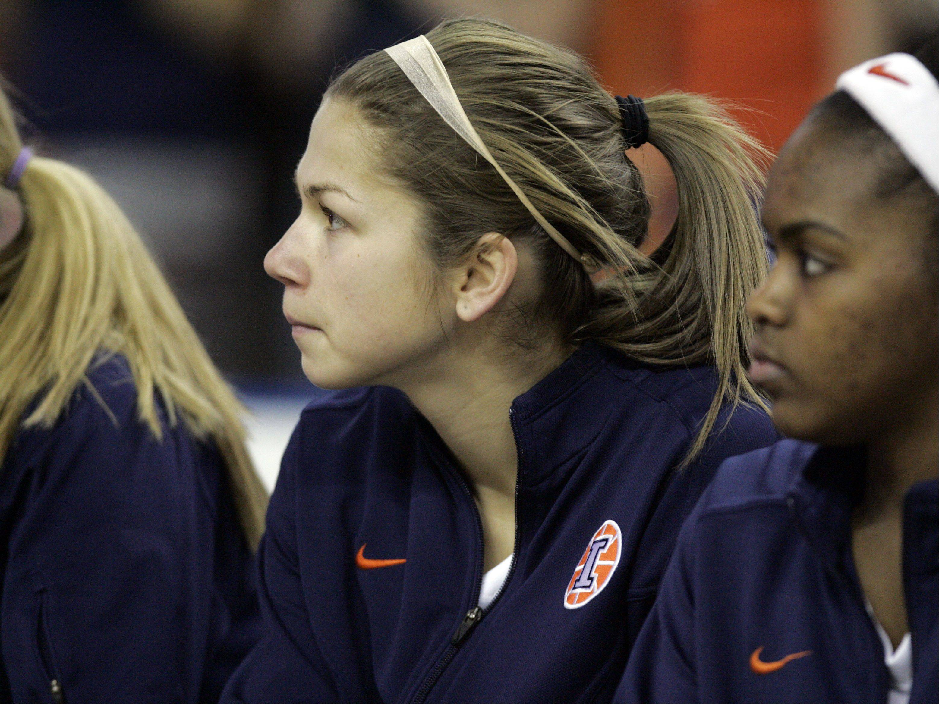 Hampshire and ECC graduate Cassie Dumoulin, who played at Illinois this season, watches from the bench the Illini's loss to Wisconsin Thursday in the Big Ten women's basketball tournament at the Sears Centre in Hoffman Estates.