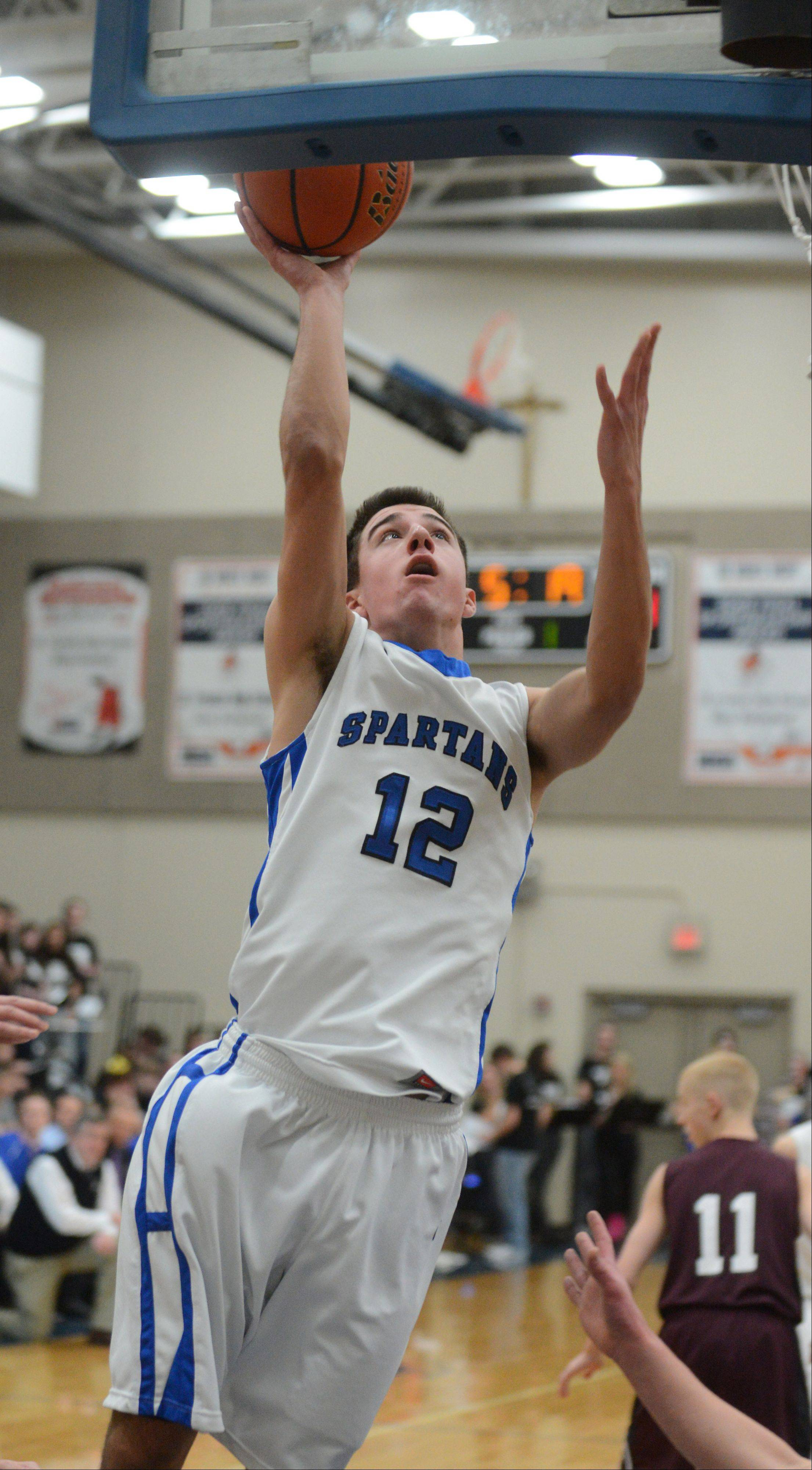 Tim Zettinger of St. Francis brings one to the net during the Wheaton Academy at St. Francis boys basketball game Friday.