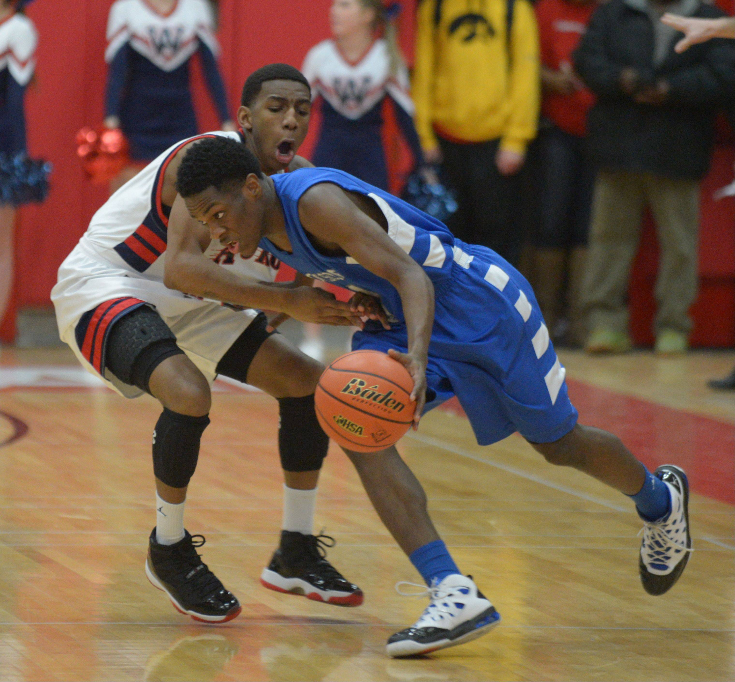 Jayquan Lee of West Aurora works Paris Lee of Proviso East during the West Aurora vs. Proviso East Class 4A Hinsdale Central boys basketball super sectional Tuesday.