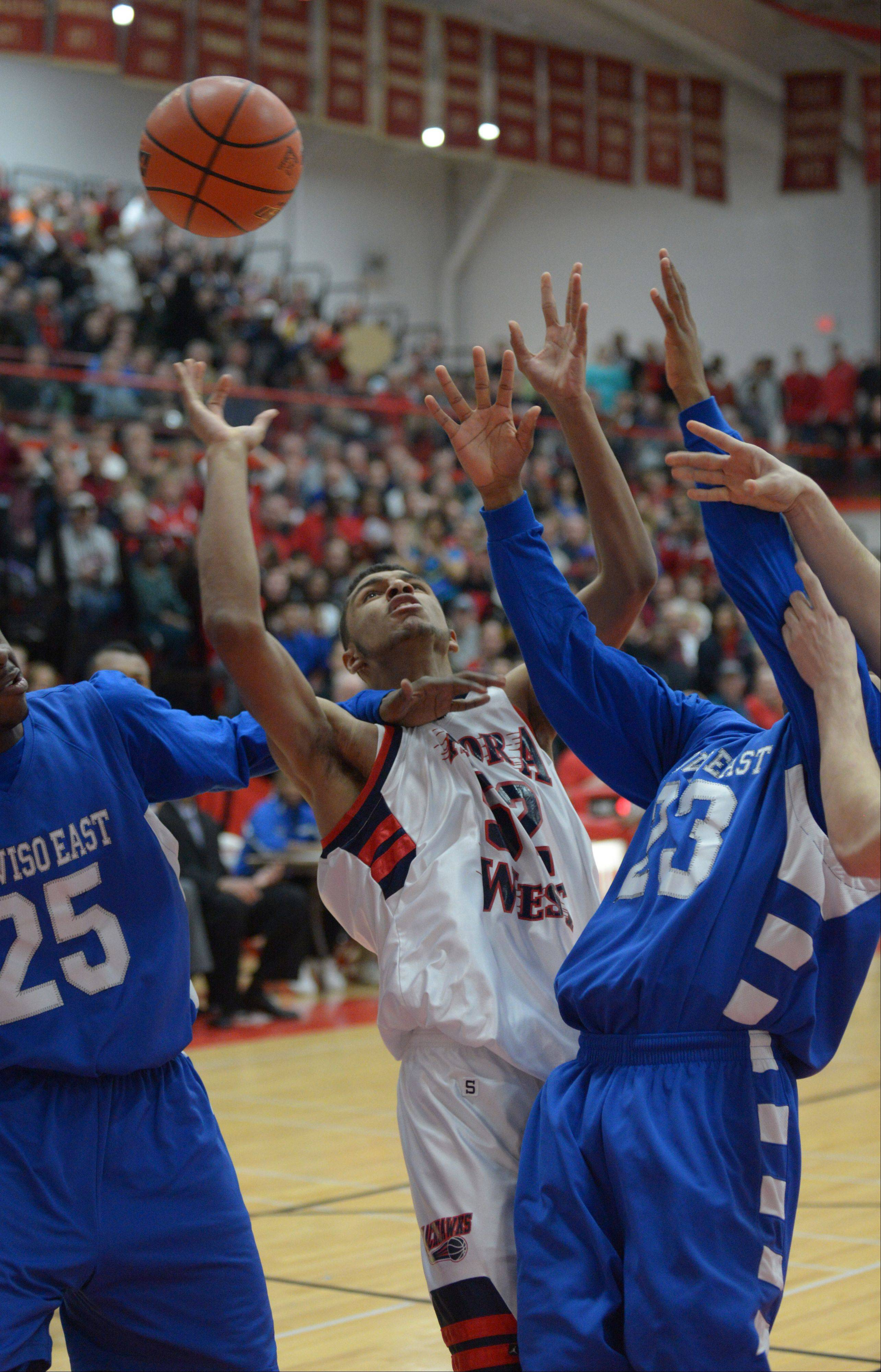 Joshua McAuley of West Aurora looks for a rebound during the West Aurora vs. Proviso East Class 4A Hinsdale Central boys basketball super sectional Tuesday.