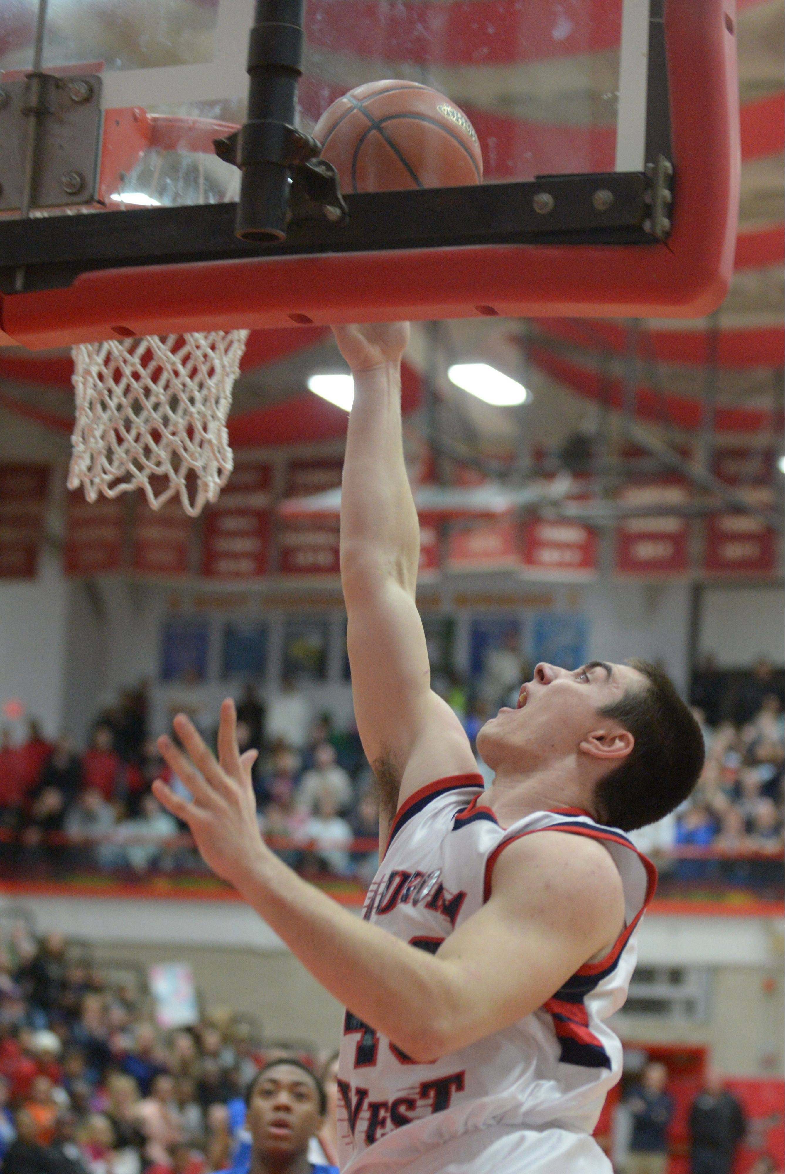 Spencer Thommas of West Aurora scored 9 points in the first quarter.