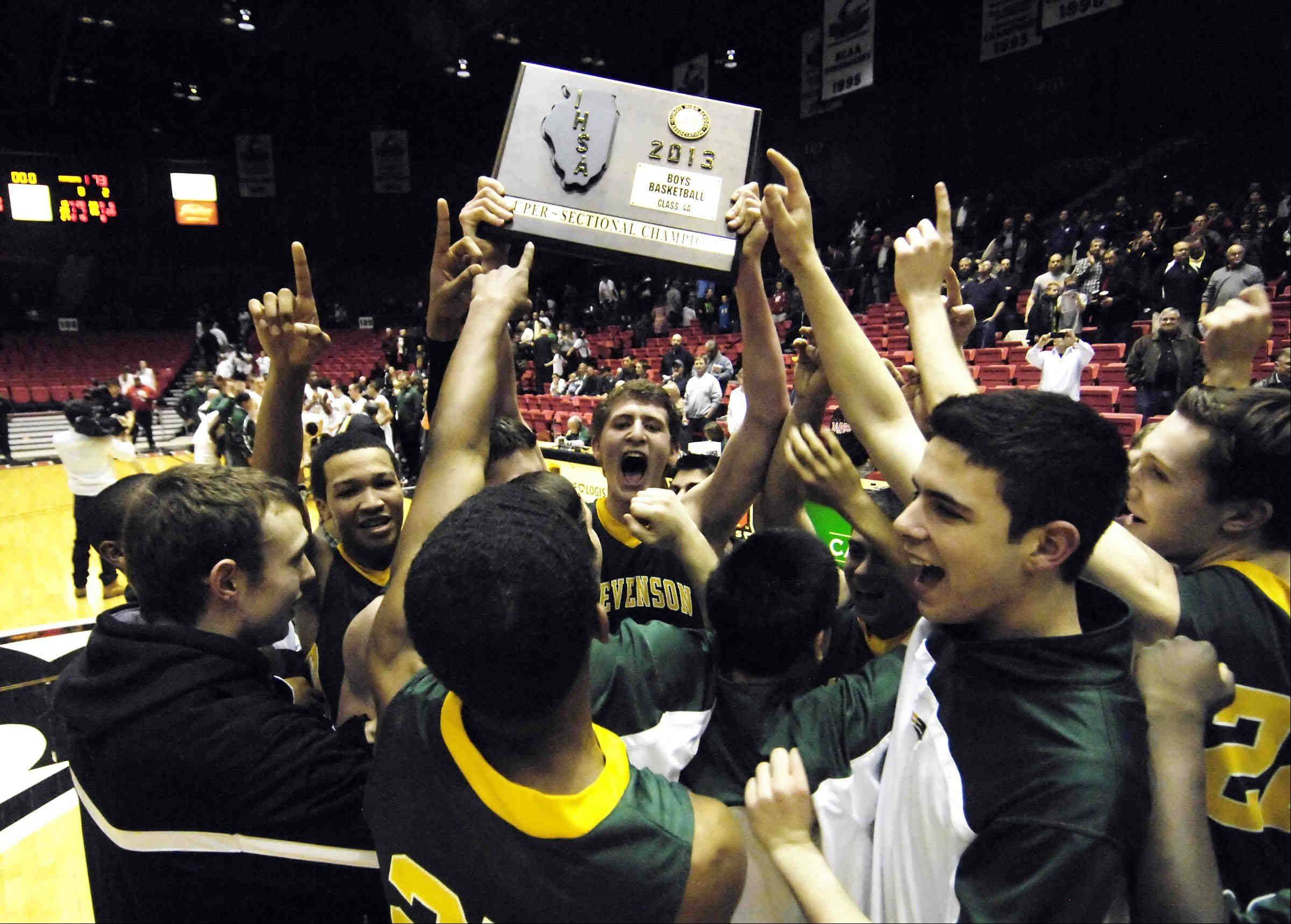 Stevenson's Andy Stempel waves the plaque after defeating Rockford Boylan Tuesday in the Class 4A NIU supersectional in Dekalb.