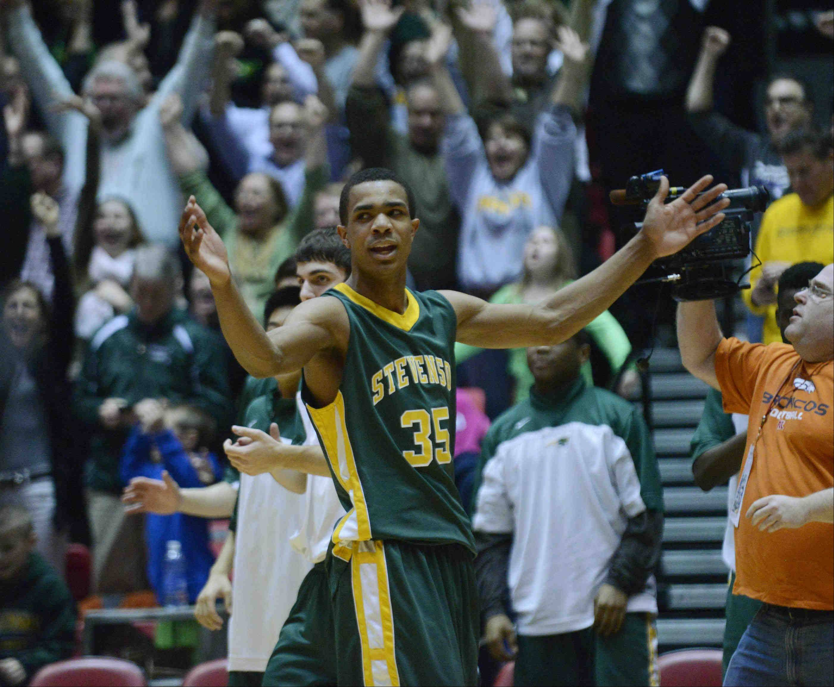 Stevenson's Connor Cashaw reacts at the buzzer as the Patriots defeat Rockford Boylan Tuesday in the Class 4A NIU supersectional game in DeKalb.