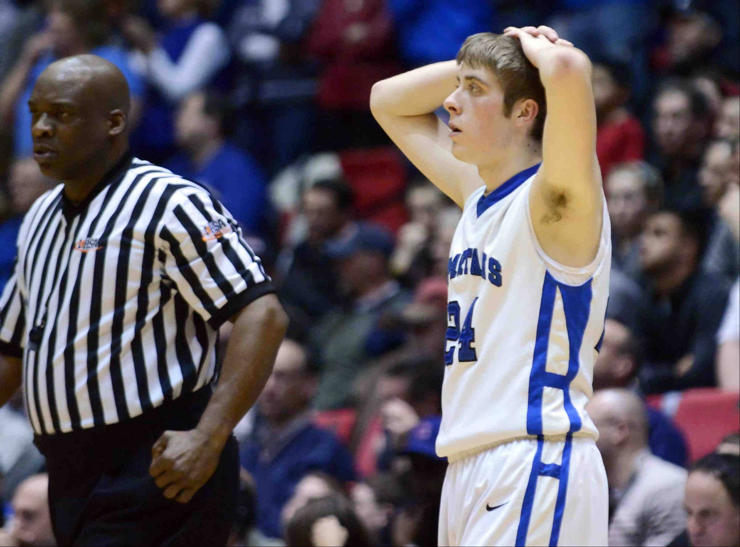 St. Francis' Matt Bonner reacts to committing his fifth foul near the end of the game against Bartonville Limestone Tuesday in the 3A Dekalb supersectional game at the Northern Illinois Convocation Center.