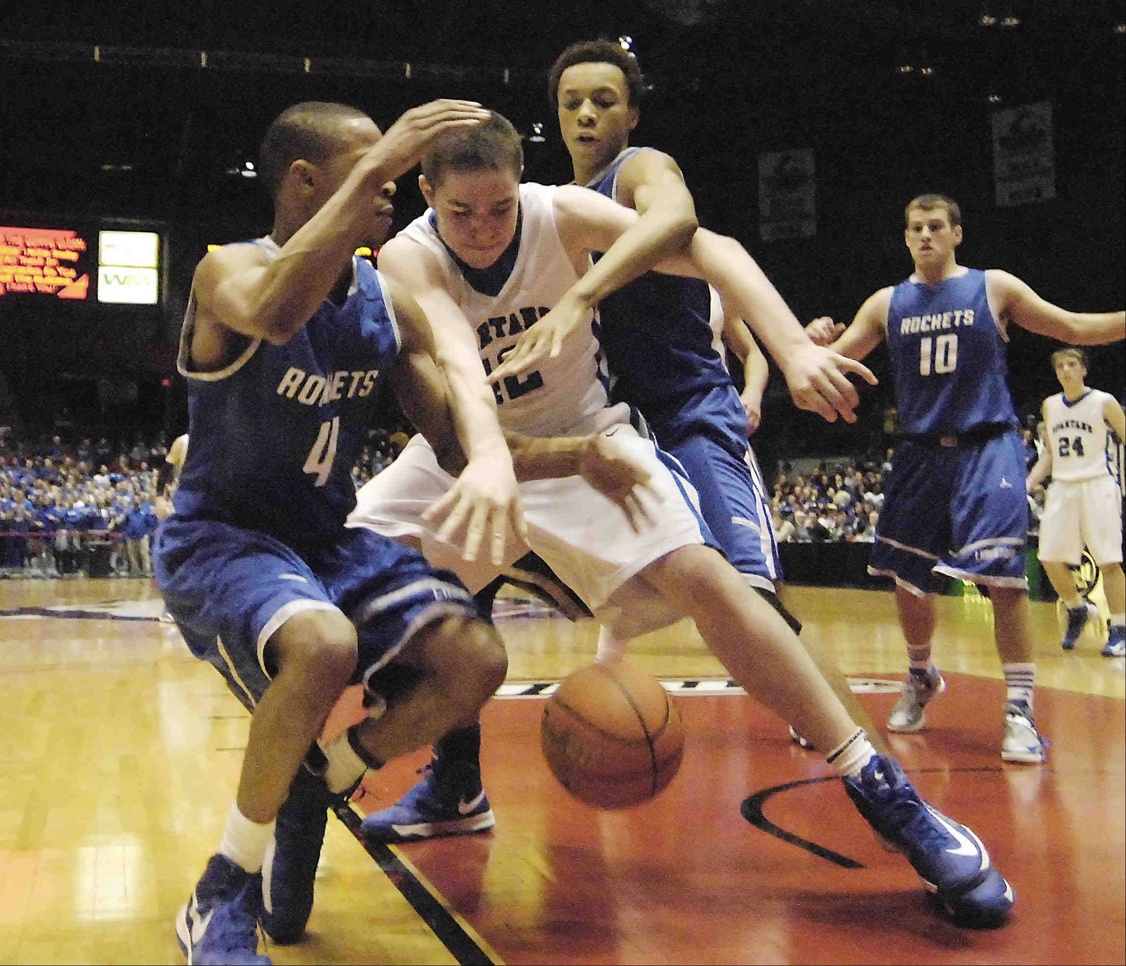 St. Francis' Killan Brown loses the ball under the defense of Bartonville Limestone's Lorenzo Burns and David Anderson late in the game Tuesday in the 3A Dekalb supersectional game at the Northern Illinois Convocation Center.