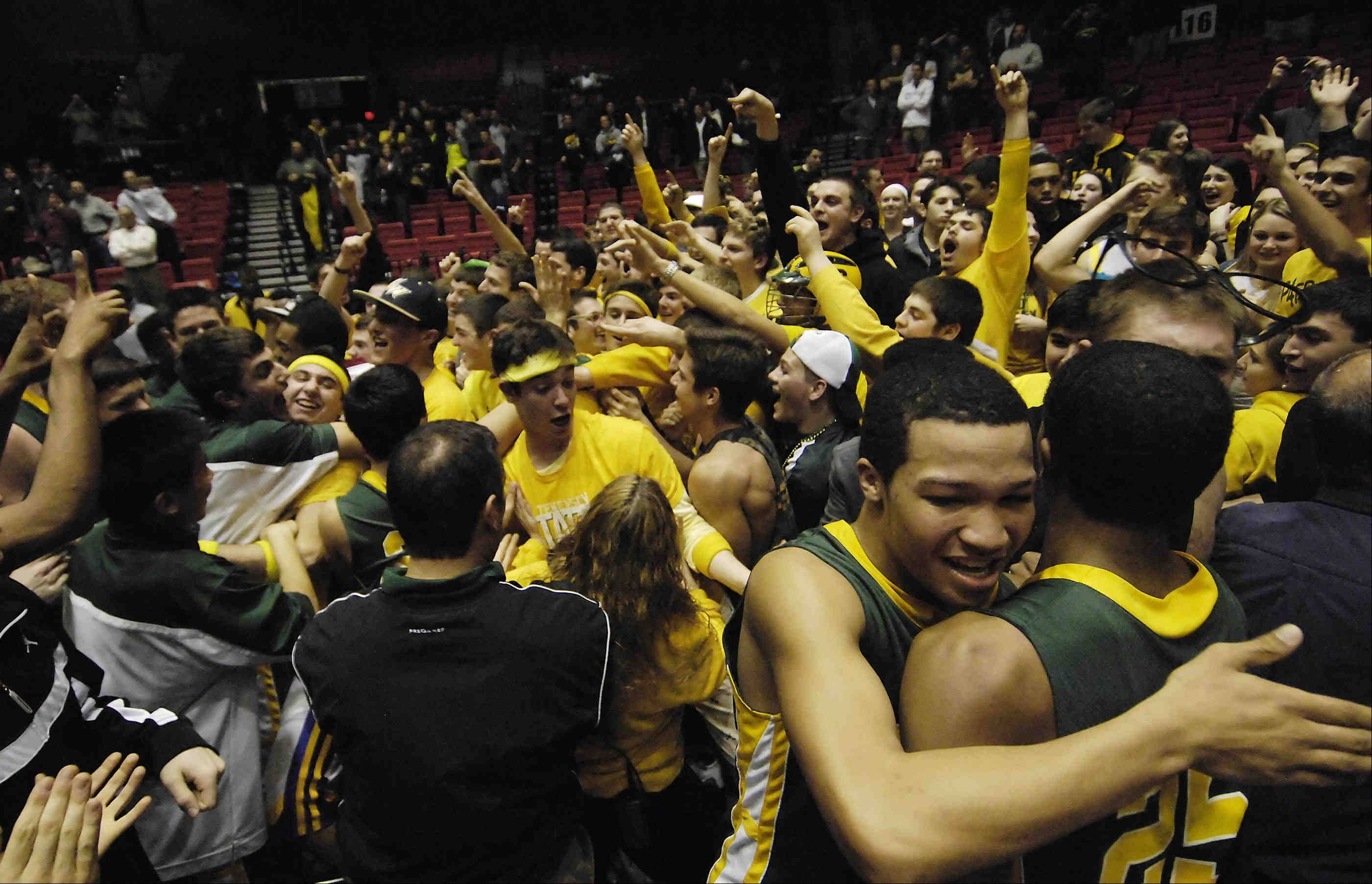 Stevenson's Jalen Brunson hugs teammate Cameron Green after the game.