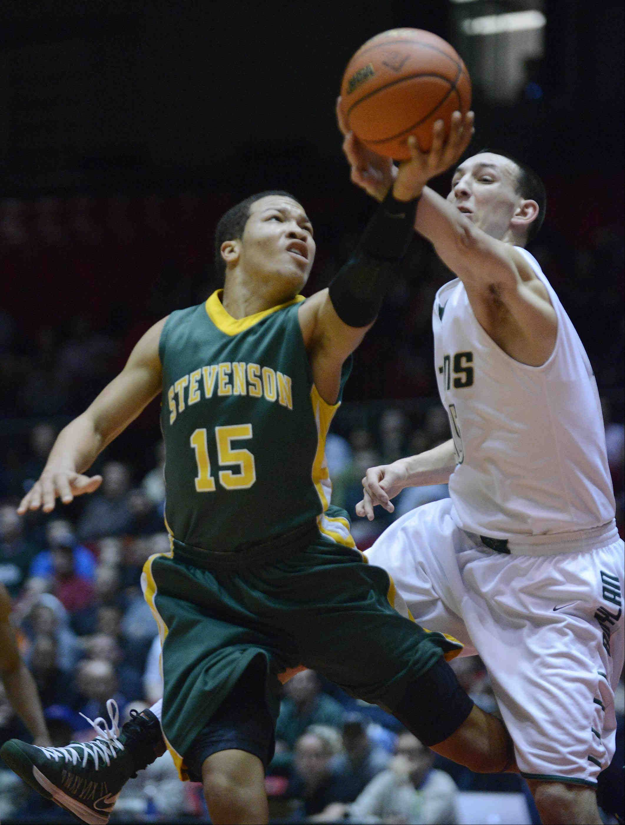 Stevenson's Jalen Brunson and Rockford Boylan's Ben Grygiel fight for a rebound.