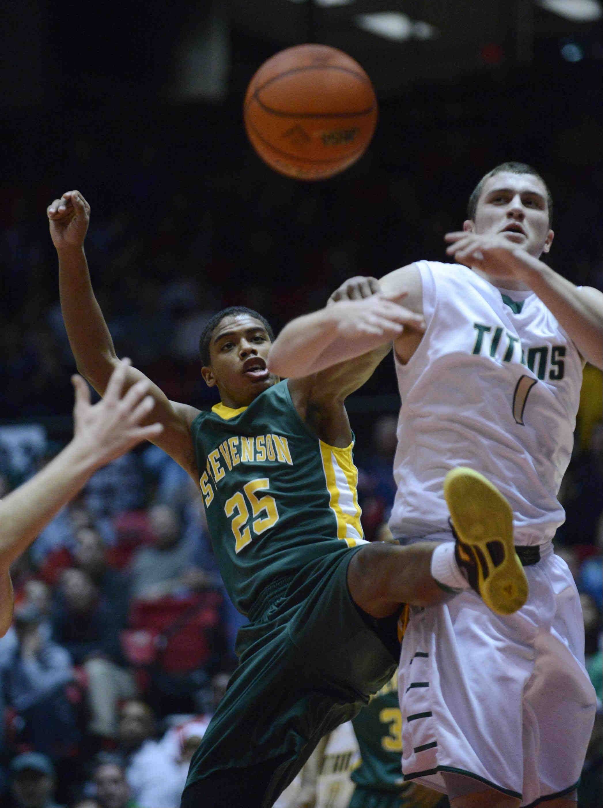 Stevenson's Cameron Green and Rockford Boylan's Jim Bridges battle under the basket.