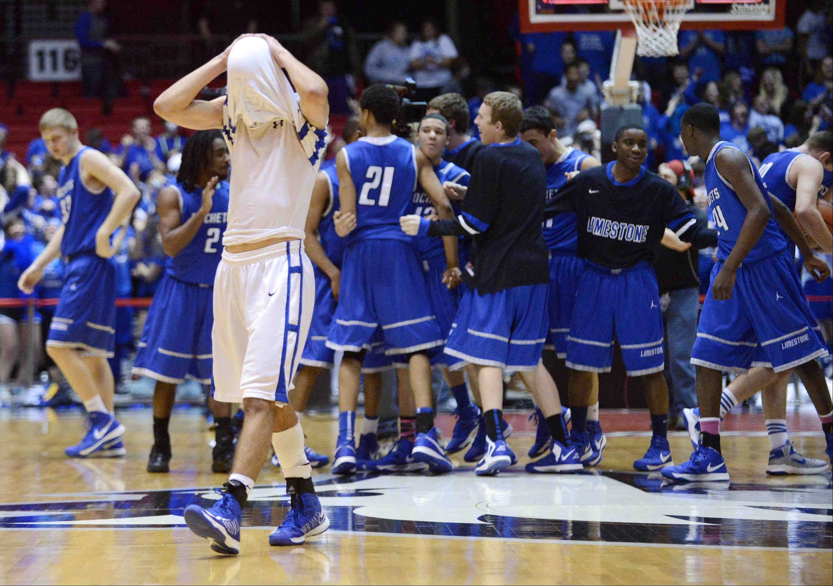 St. Francis' Tim Zettinger reacts as Bartonville Limestone players celebrate.