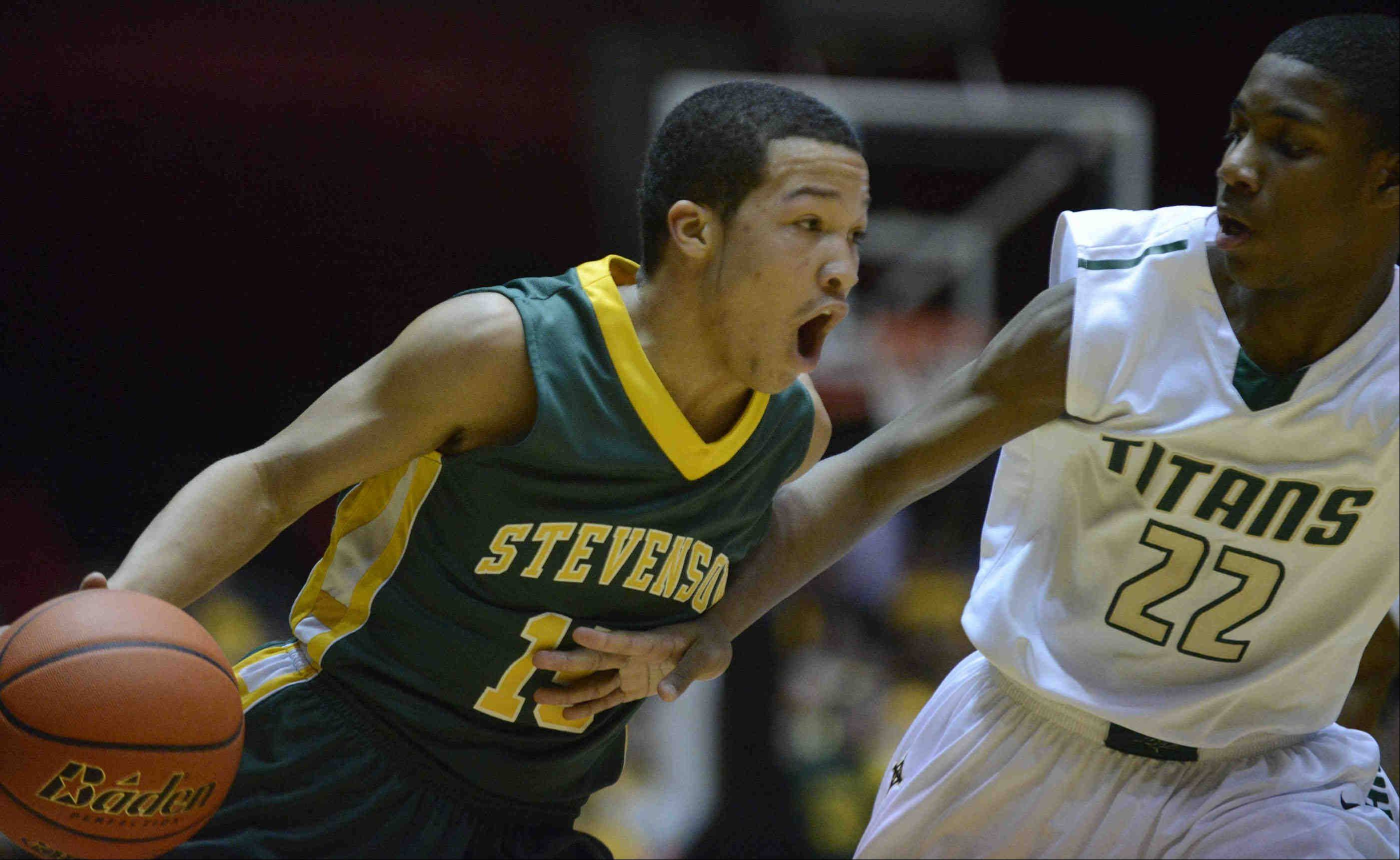 Stevenson point guard Jalen Brunson drives to the basket against Rockford Boylan during Tuesday night's Class 4A NIU supersectional.