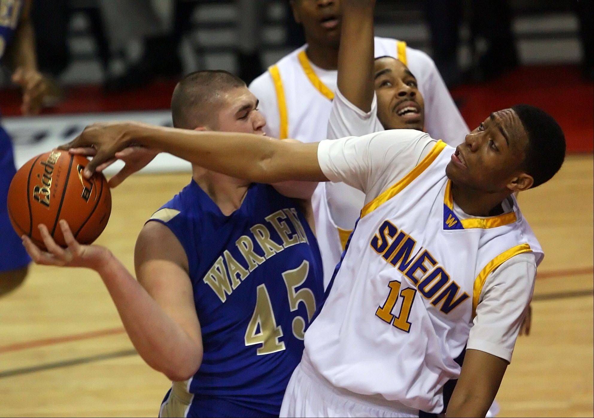 Steve Lundy/slundy@dailyherald.comSimeon and Jabari Parker, at right defending against Warren's Nathan Boothe in last season's Class 4A state title game, are going after a fourth straight state championship in Peoria this weekend.