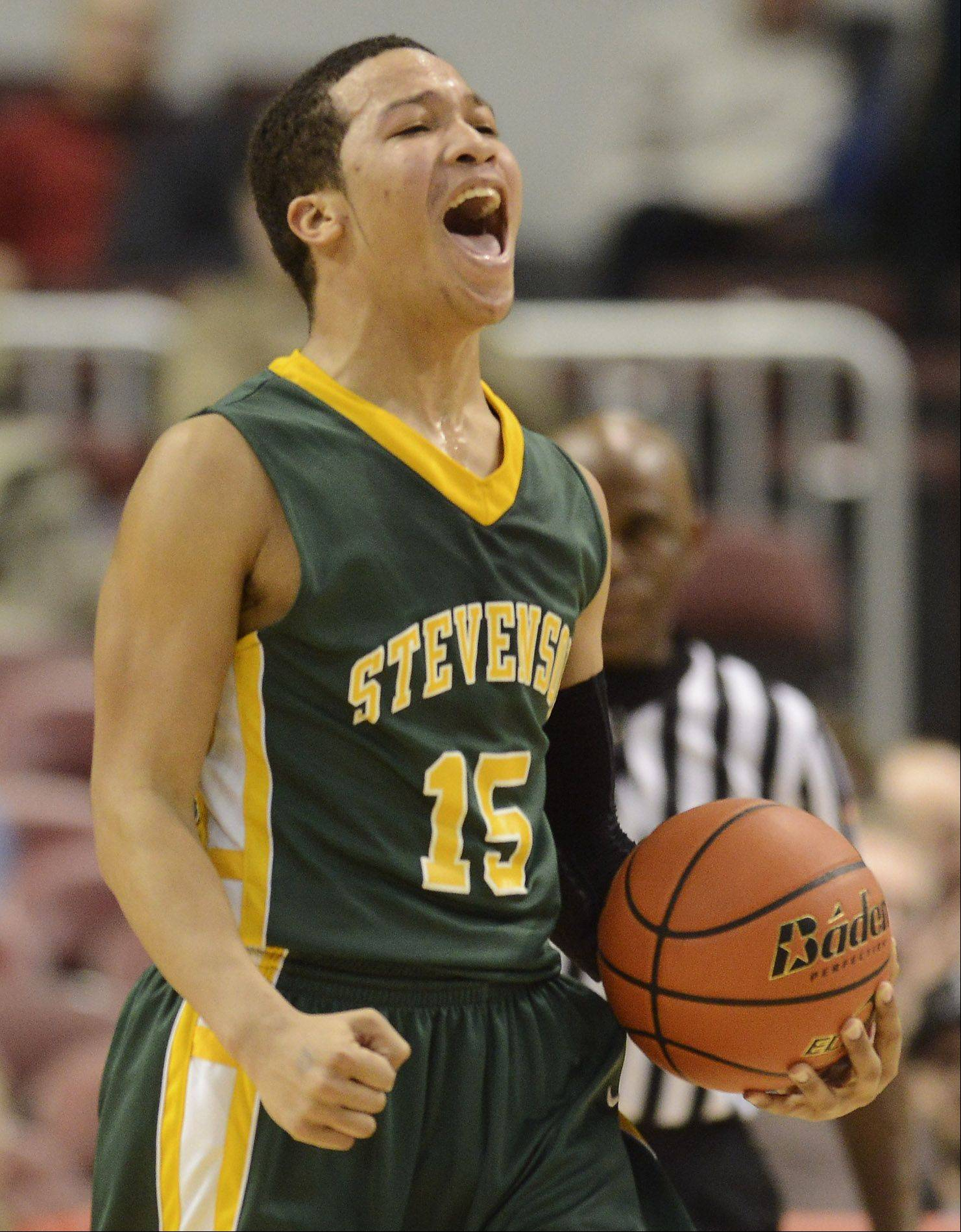 Stevenson's Jalen Brunson lets out a shout as his team closes in on a victory over Edwardsville during the Class 4A boys basketball state semifinals at Carver Arena in Peoria on Friday.