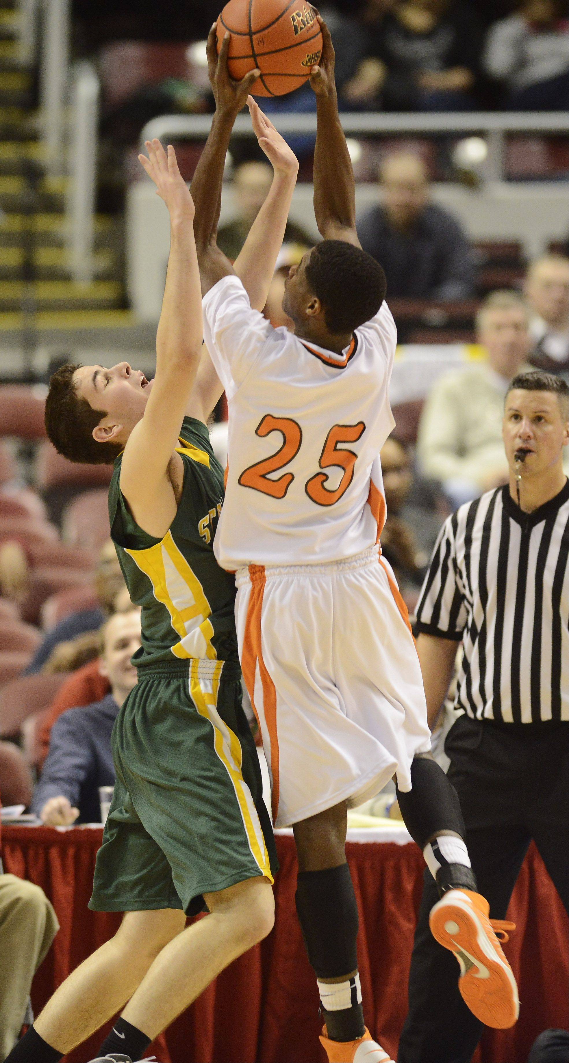 Stevenson's Matt Morrissey, left, closely guards Edwardsville's Armon Fletcher during the Class 4A boys basketball state semifinals at Carver Arena in Peoria on Friday.