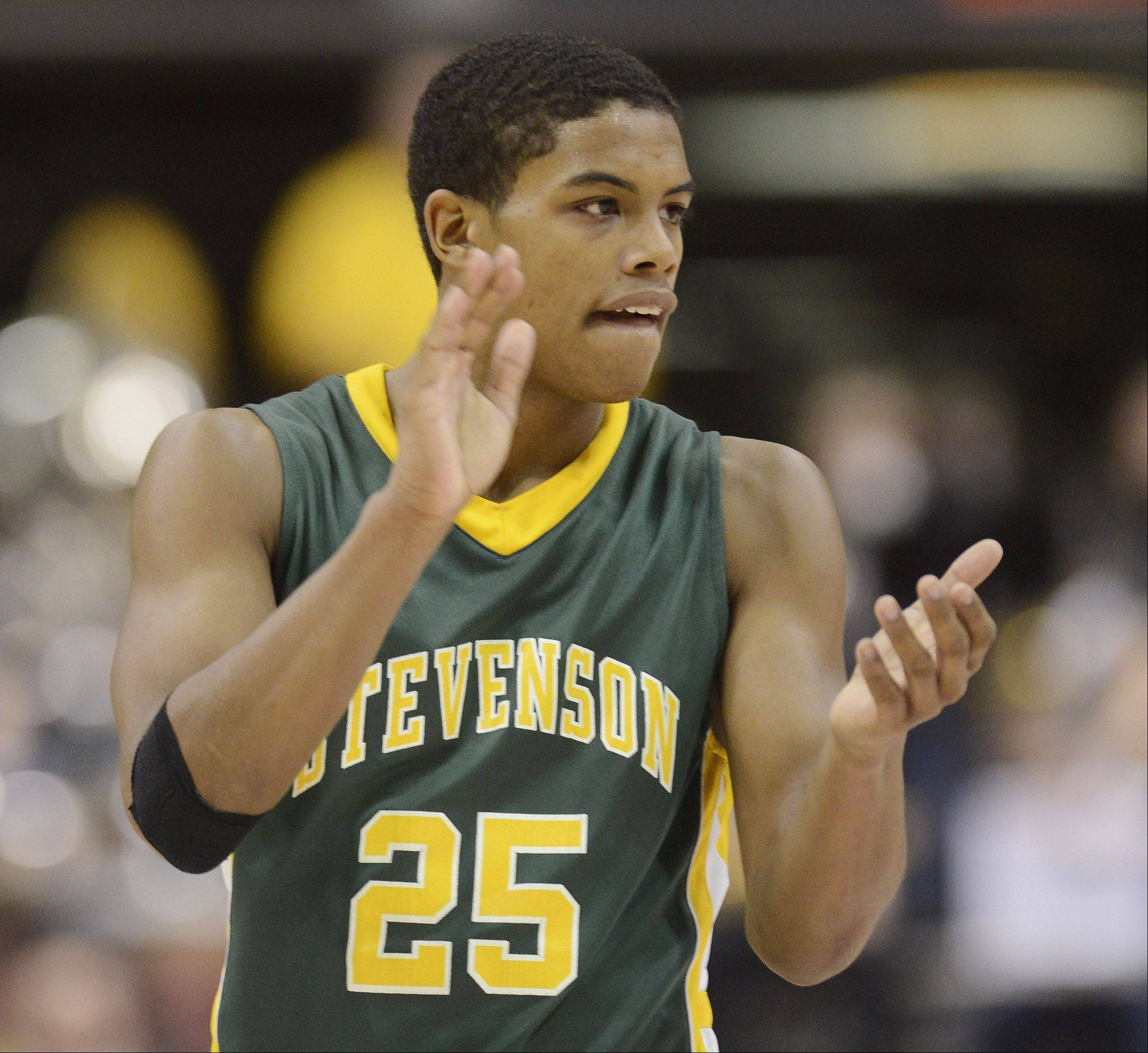 Stevenson's Cameron Green claps for his team as the Patriots close in on a victory over Edwardsville during the Class 4A boys basketball state semifinals at Carver Arena in Peoria on Friday.