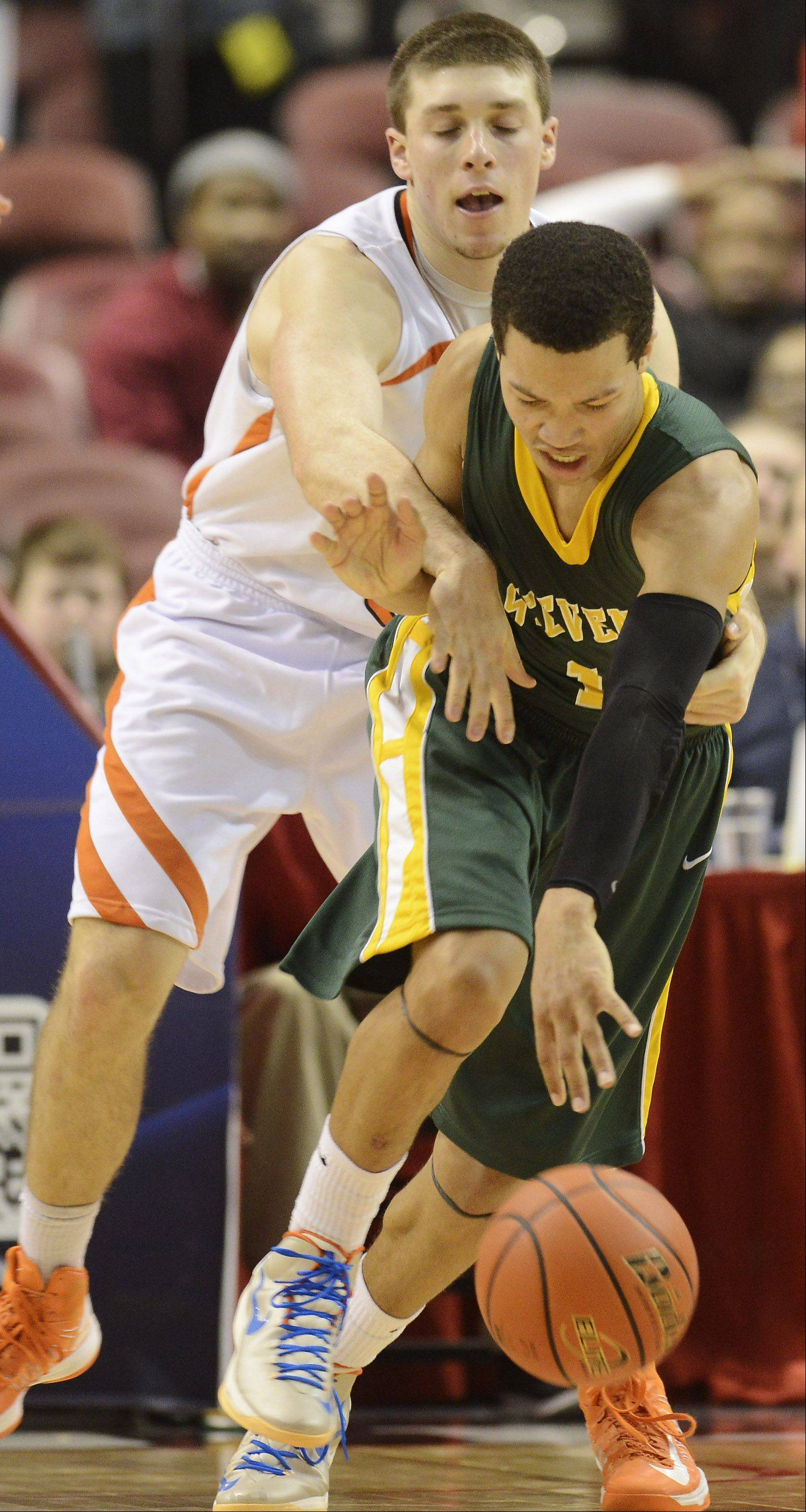 Edwardsville's Drew Curtis, left, fouls Stevenson's Jalen Brunson during the Class 4A boys basketball state semifinals Friday at Carver Arena in Peoria.