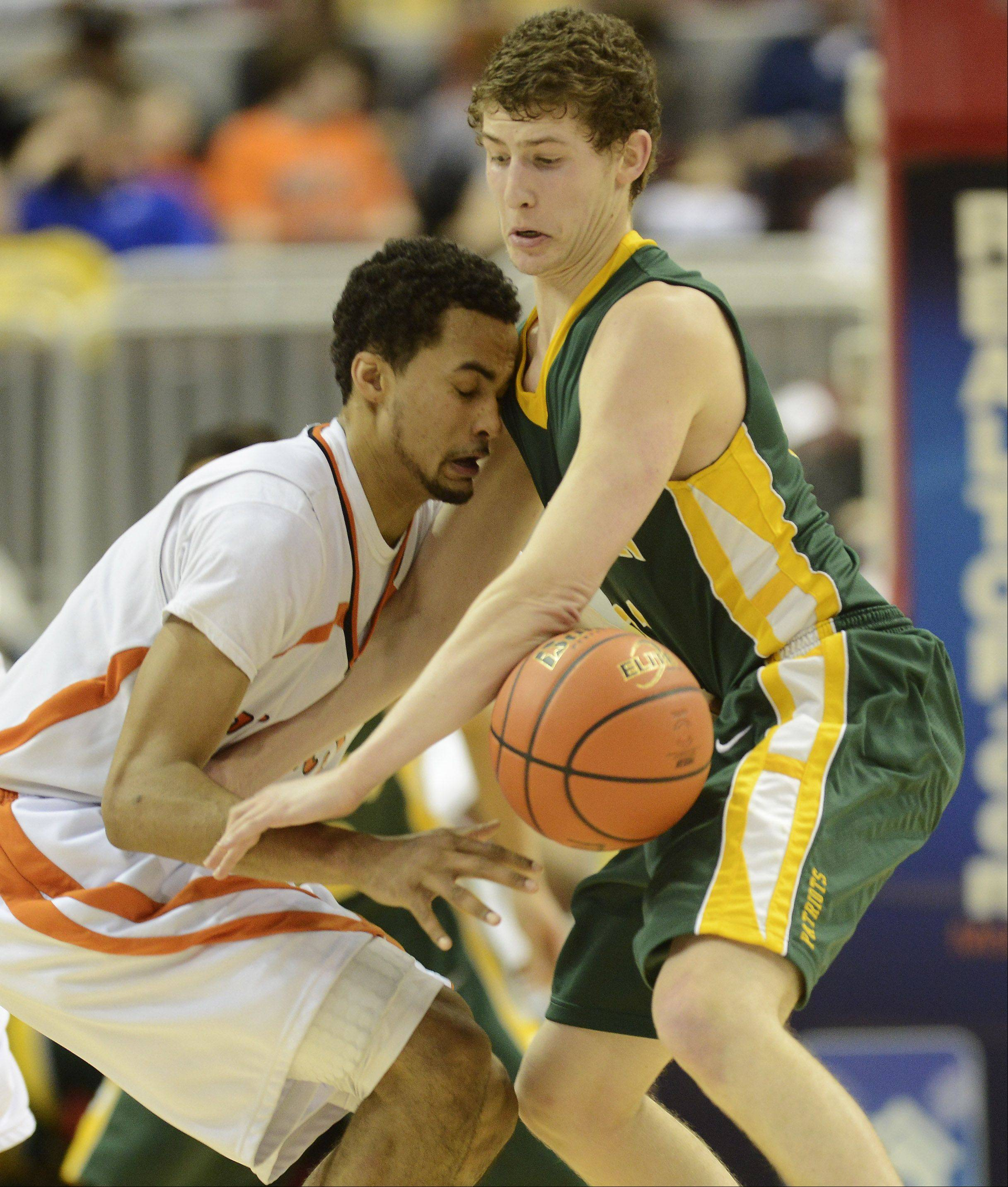Stevenson's Andrew Stempel, right, takes the ball from Edwardsville's Tre' Harris during the Class 4A boys basketball state semifinals at Carver Arena in Peoria on Friday.