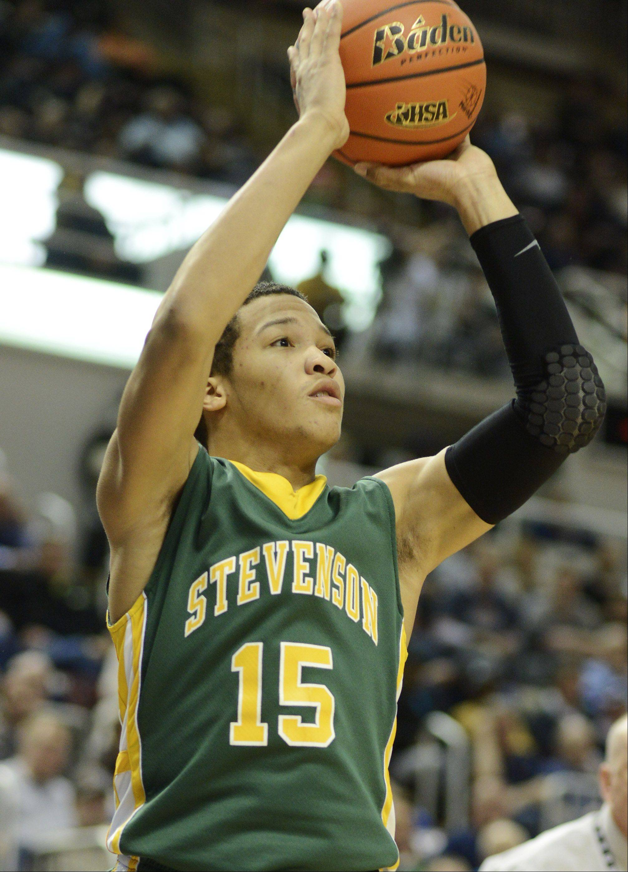 Stevenson's Jalen Brunson hits a shot from the corner during the Class 4A boys basketball state semifinals at Carver Arena in Peoria on Friday.