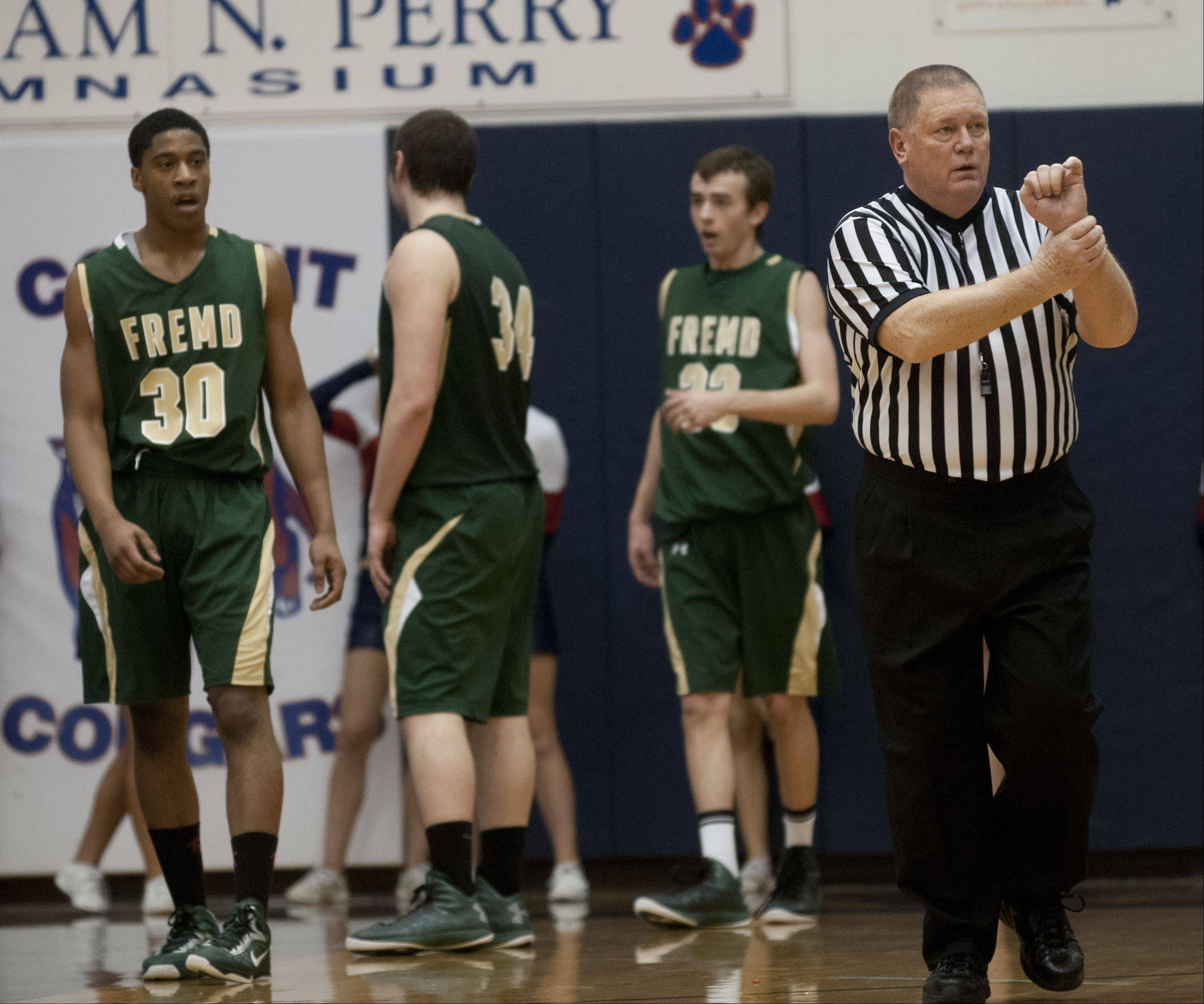 Longtime IHSA referee Rick Bieterman calls a foul during a game between Fremd and Conant high schools.