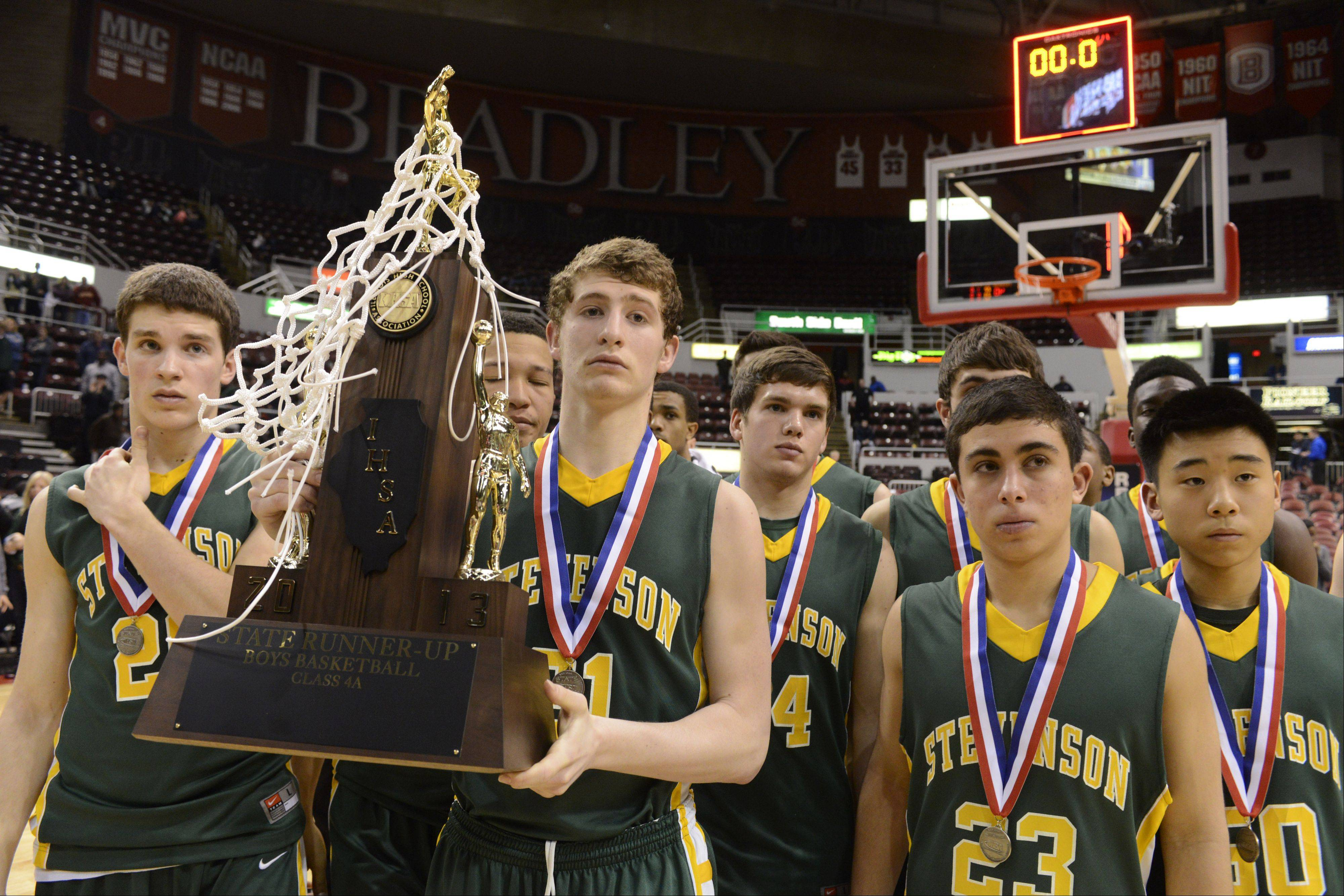 Stevenson's Andrew Stempel holds the team's second-place trophy following the Class 4A state championship game at Carver Arena in Peoria, where the Patriots fell to Simeon on Saturday night.